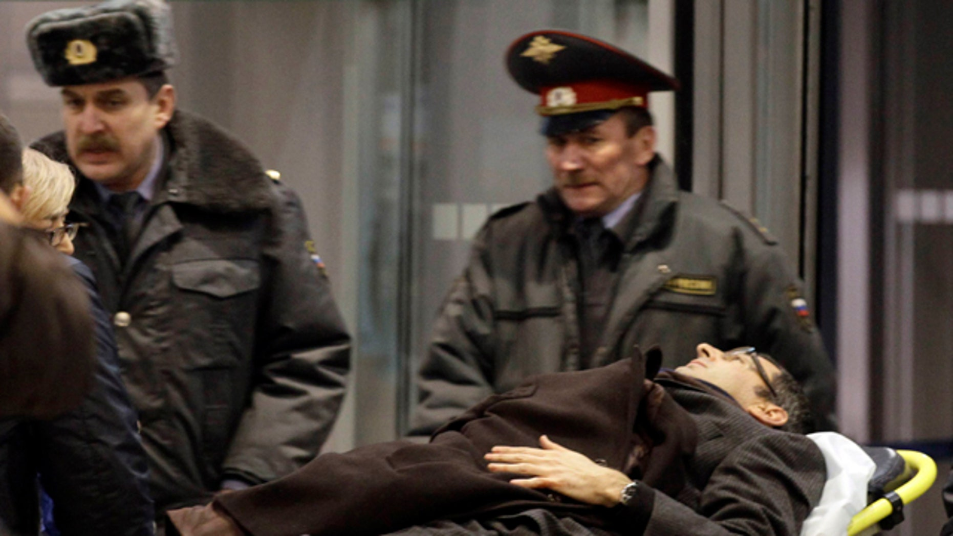 A man wounded in a blast is evacuated from Domodedovo airport in Moscow, Monday, Jan. 24, 2011. An explosion ripped through the international arrivals hall at Moscow's busiest airport on Monday, killing dozens of people and wounding scores, officials said. The Russian president called it a terror attack. (AP Photo/Ivan Sekretarev)