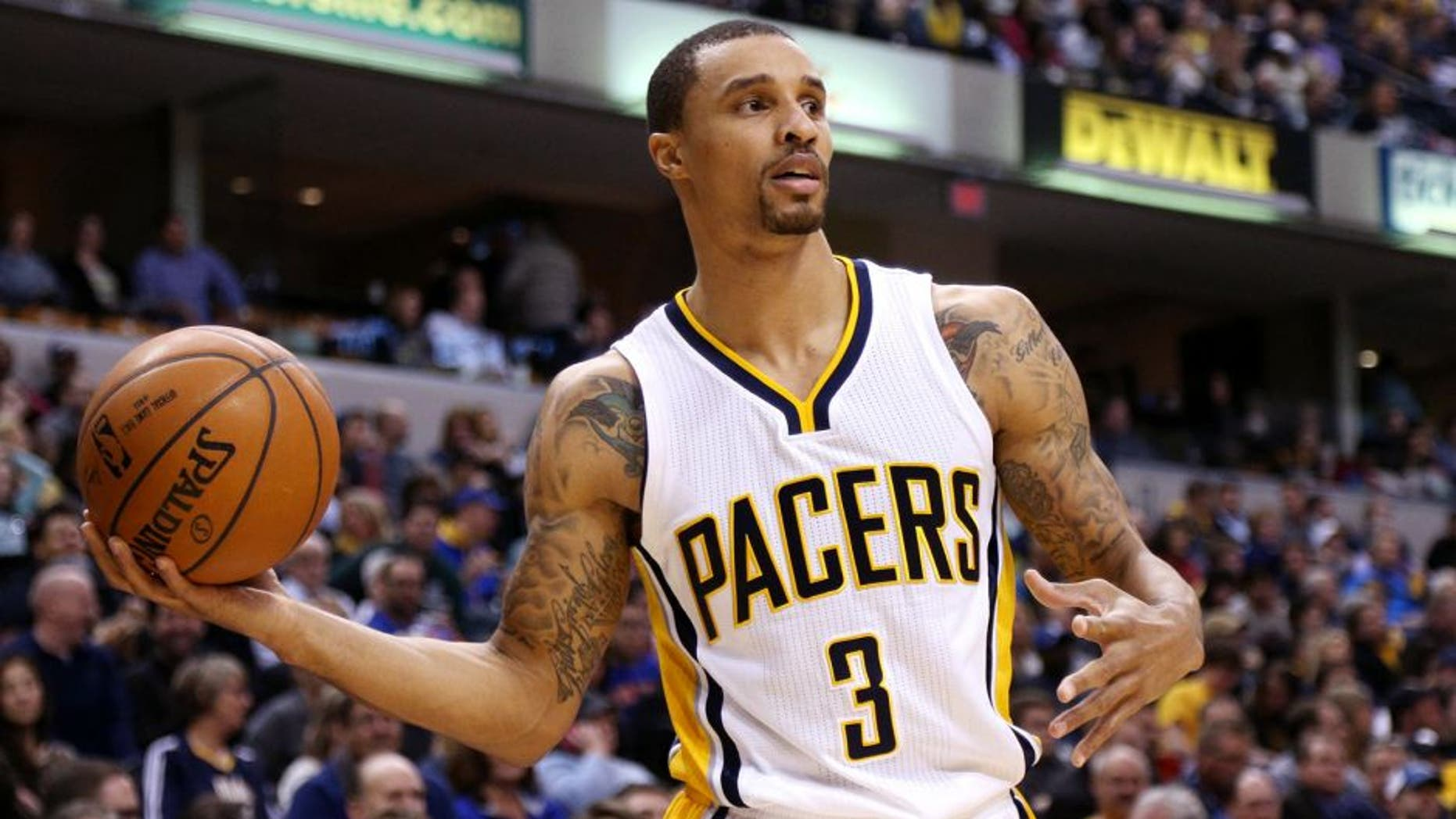 Jan 29, 2015; Indianapolis, IN, USA; Indiana Pacers guard George Hill (3) looks to make a pass against the New York Knicks at Bankers Life Fieldhouse. Indiana defeats New York 103-82. Mandatory Credit: Brian Spurlock-USA TODAY Sports