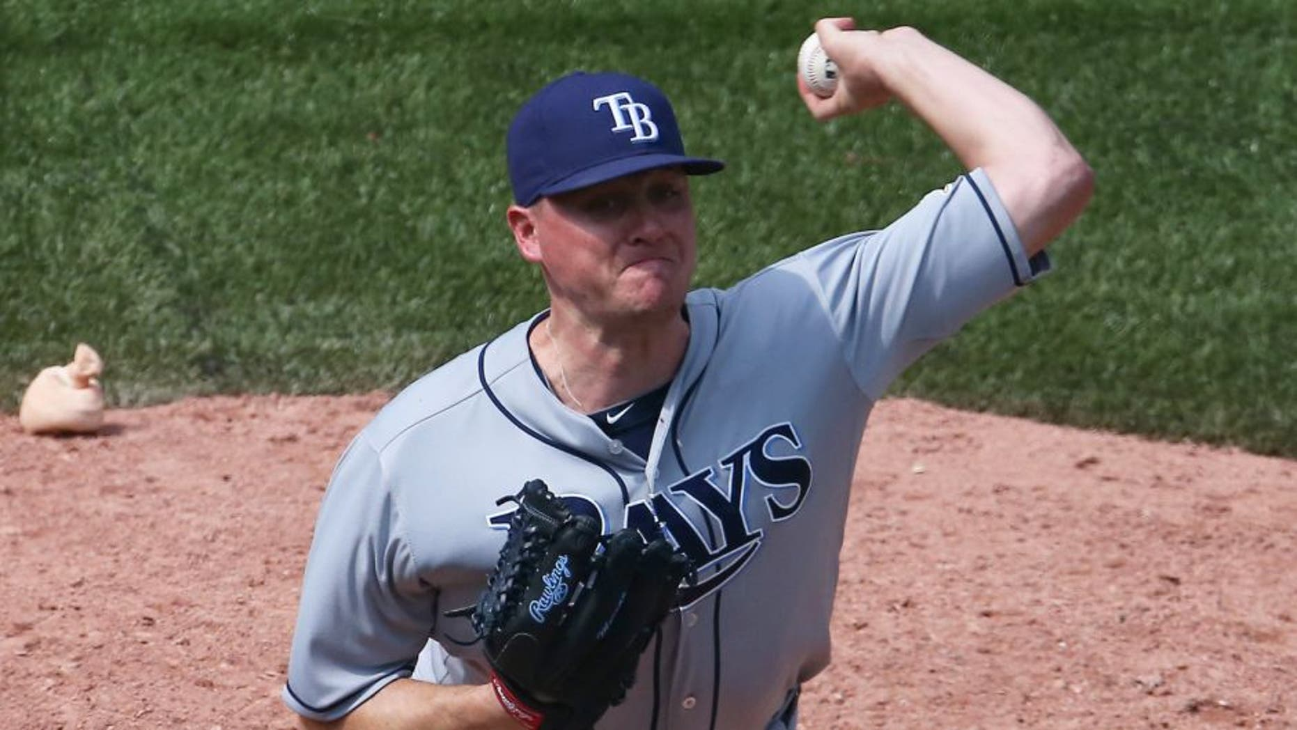 TORONTO, CANADA - JULY 18: Jake McGee #57 of the Tampa Bay Rays delivers a pitch in the ninth inning during MLB game action against the Toronto Blue Jays on July 18, 2015 at Rogers Centre in Toronto, Ontario, Canada. (Photo by Tom Szczerbowski/Getty Images)