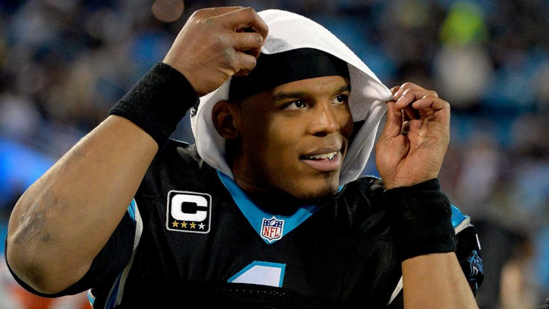 CHARLOTTE, NC - JANUARY 03: Cam Newton #1 of the Carolina Panthers watches from the sideline during the final minute of their game against the Tampa Bay Buccaneers at Bank of America Stadium on January 3, 2016 in Charlotte, North Carolina. The Panthers won 38-10 to clinch home field advantage for the playoffs. (Photo by Grant Halverson/Getty Images)