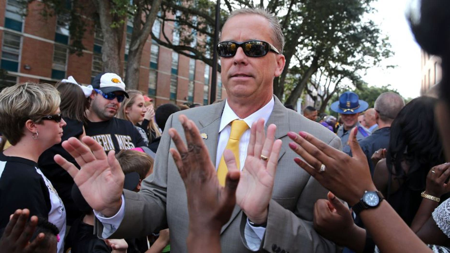 Oct 17, 2015; Hattiesburg, MS, USA; Southern Miss Golden Eagles head coach Todd Monken greets fans during Eagle Walk before their game against the UTSA Roadrunners at M.M. Roberts Stadium. Mandatory Credit: Chuck Cook-USA TODAY Sports