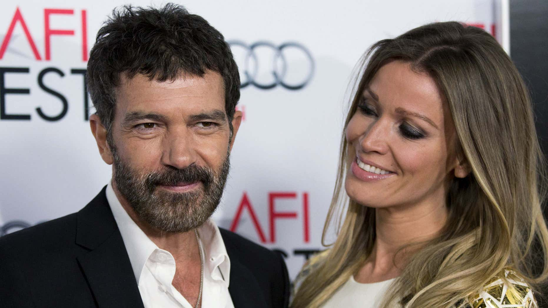 """Nov. 9, 2015: Cast member Antonio Banderas (L) and Nicole Kimpel pose at the screening of """"The 33"""" during AFI Fest 2015 in Hollywood, Calif."""