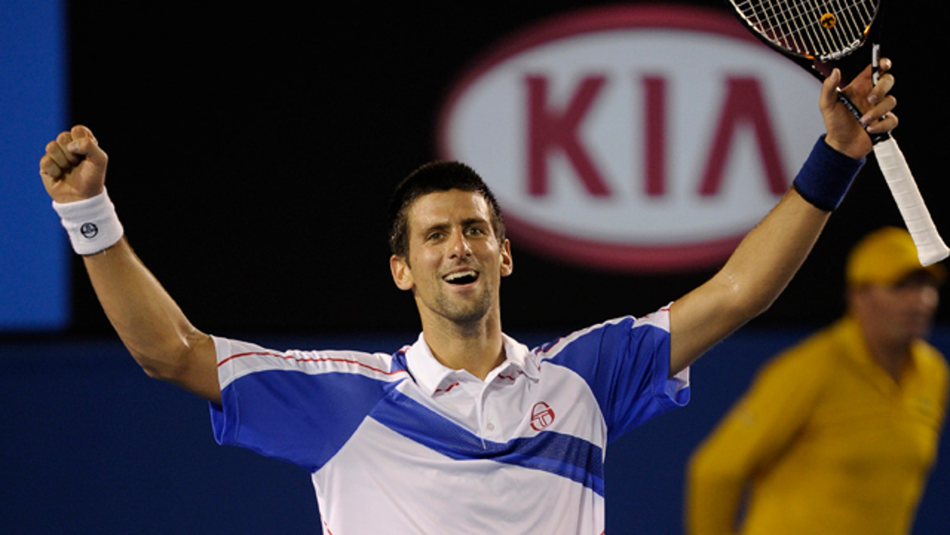 Jan. 30: Serbia's Novak Djokovic raises his arms in celebration after defeating Britain's Andy Murray in the men's singles final at the Australian Open tennis championships in Melbourne, Australia.