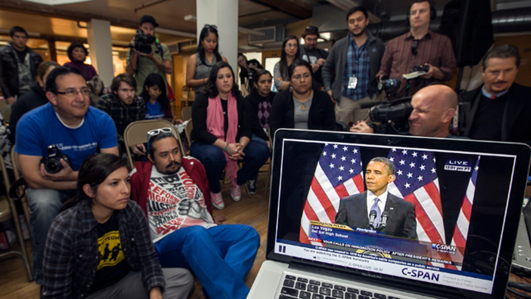 Members of the DREAM Team LA, a Los Angeles immigrants rights group, watch a live video stream of President Obama, Jan. 29, 2013.