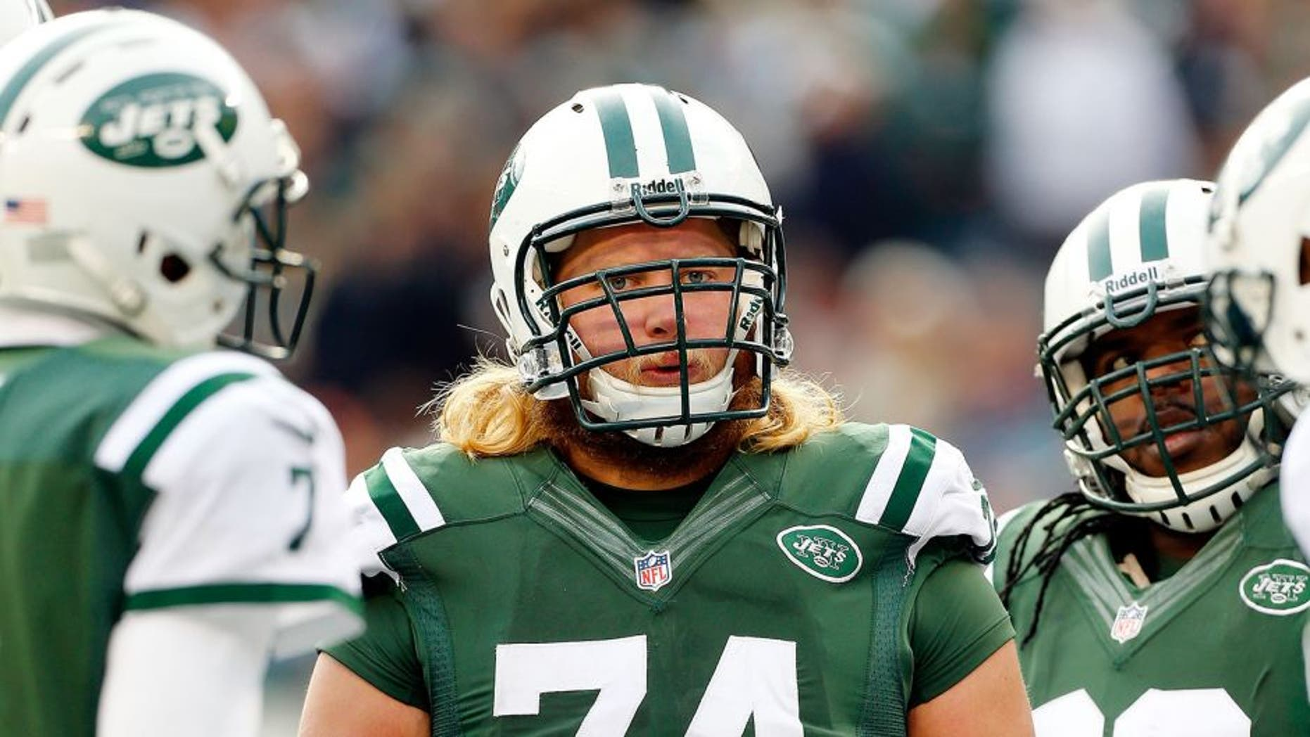 EAST RUTHERFORD, NJ - DECEMBER 01: (NEW YORK DAILIES OUT) Nick Mangold #74 of the New York Jets looks on against the Miami Dolphins on December 1, 2013 at MetLife Stadium in East Rutherford, New Jersey. The Dolphins defeated the Jets 23-3. (Photo by Jim McIsaac/Getty Images) *** Local Caption *** Nick Mangold