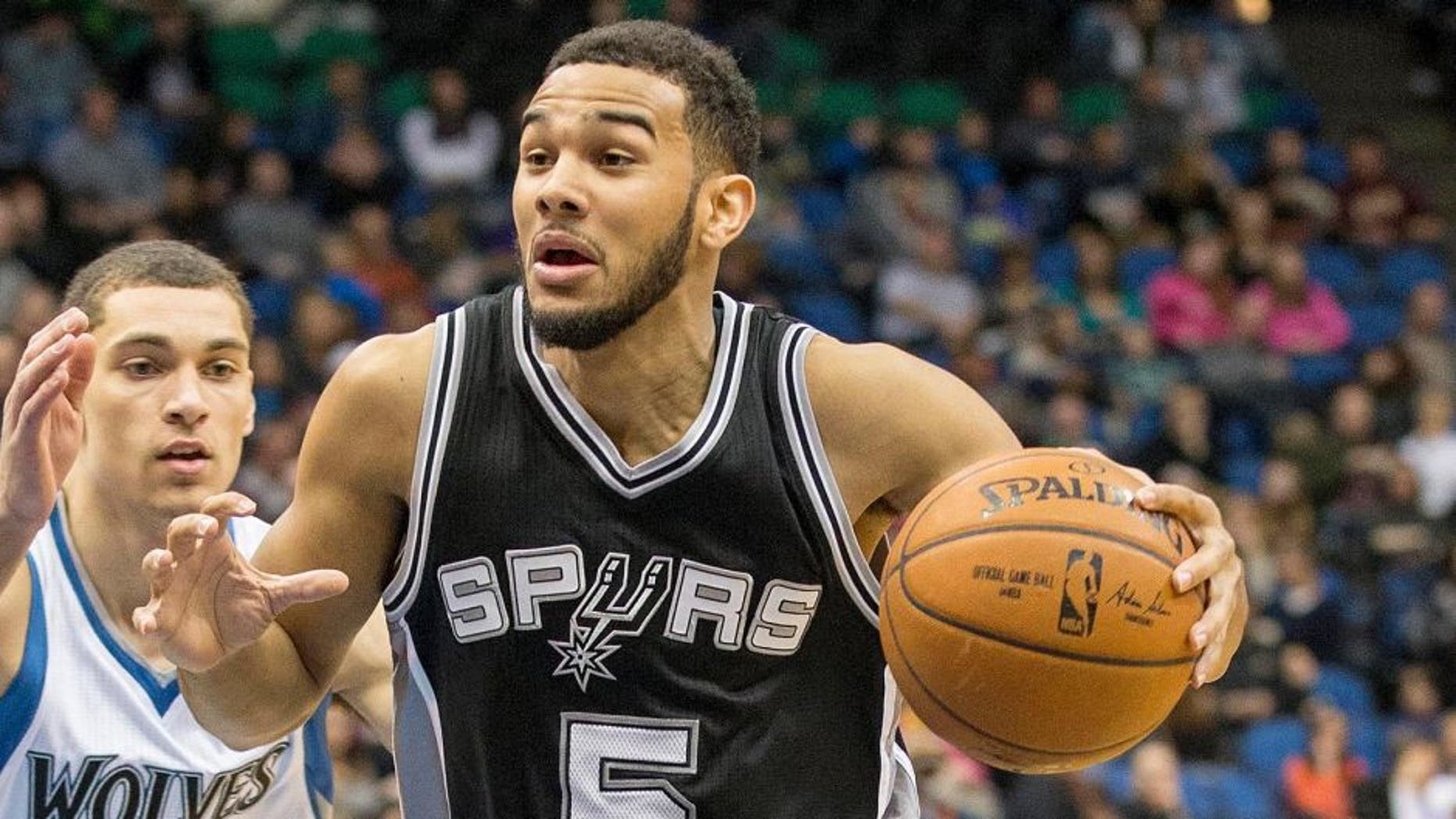 Jan 10, 2015; Minneapolis, MN, USA; San Antonio Spurs guard Cory Joseph (5) drives to the basket in the second half against the Minnesota Timberwolves at Target Center. The Spurs won 108-93. Mandatory Credit: Jesse Johnson-USA TODAY Sports