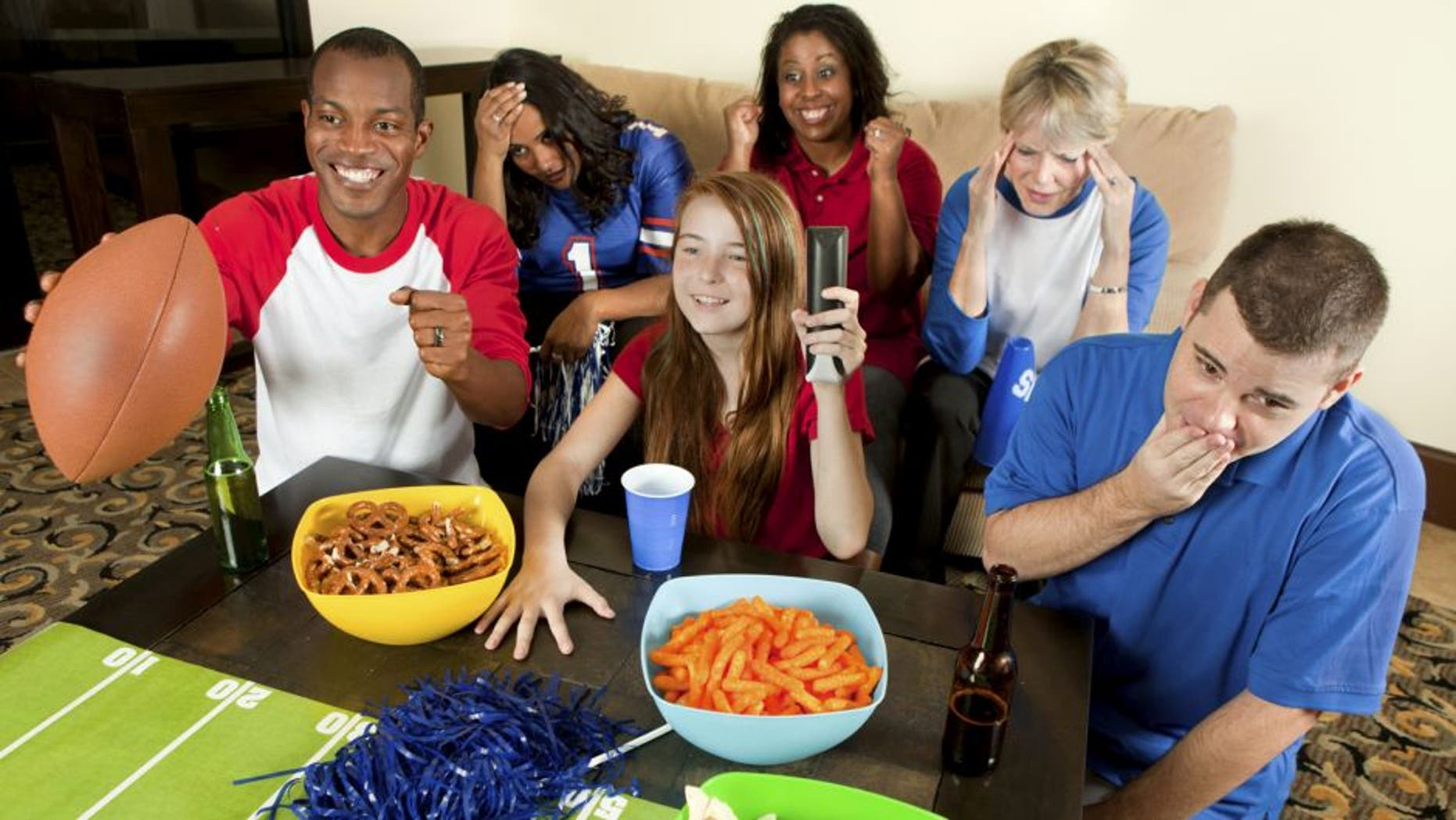 Diverse Group of Family and Friends Watching a Football Game