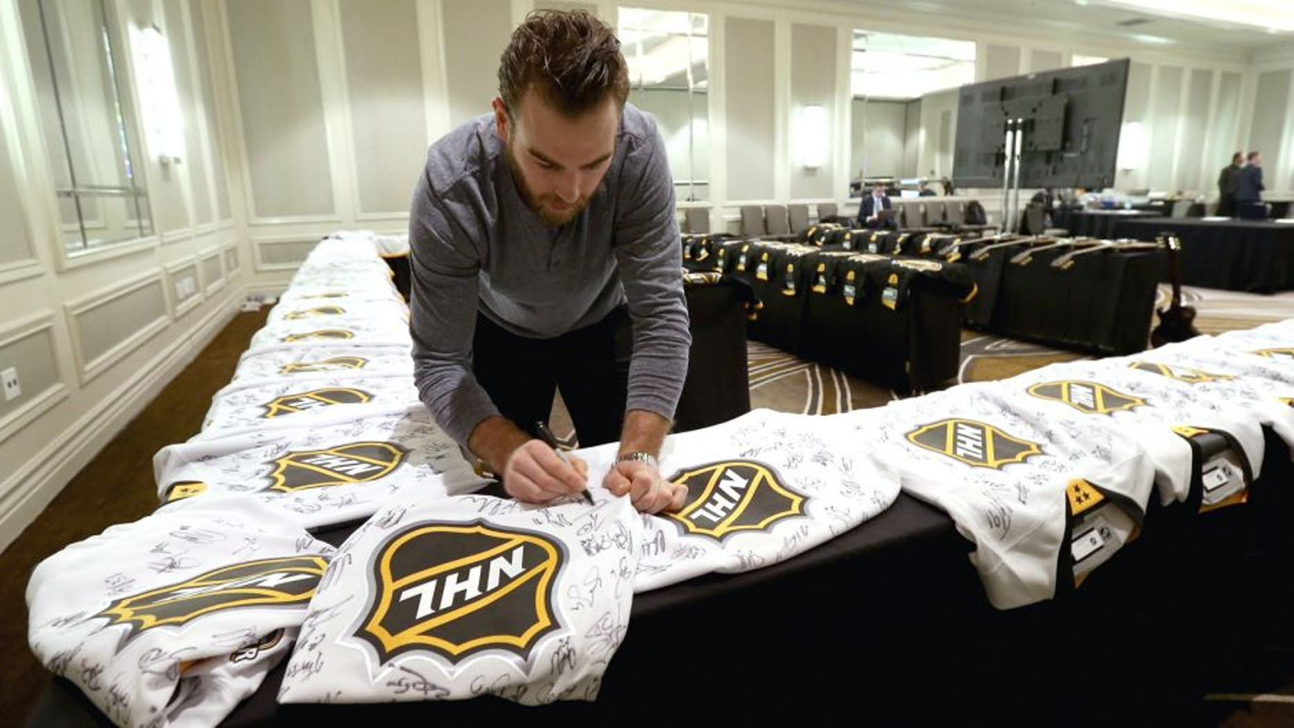 NASHVILLE, TN - JANUARY 29: Goaltender Braden Holtby #70 of the Washington Capitals signs jerseys during the Eastern Conference Skills Competition selection for the 2016 NHL All-Star Game at the Hilton Hotel on January 29, 2016 in Nashville, Tennessee. (Photo by Dave Sandford/NHLI via Getty Images)