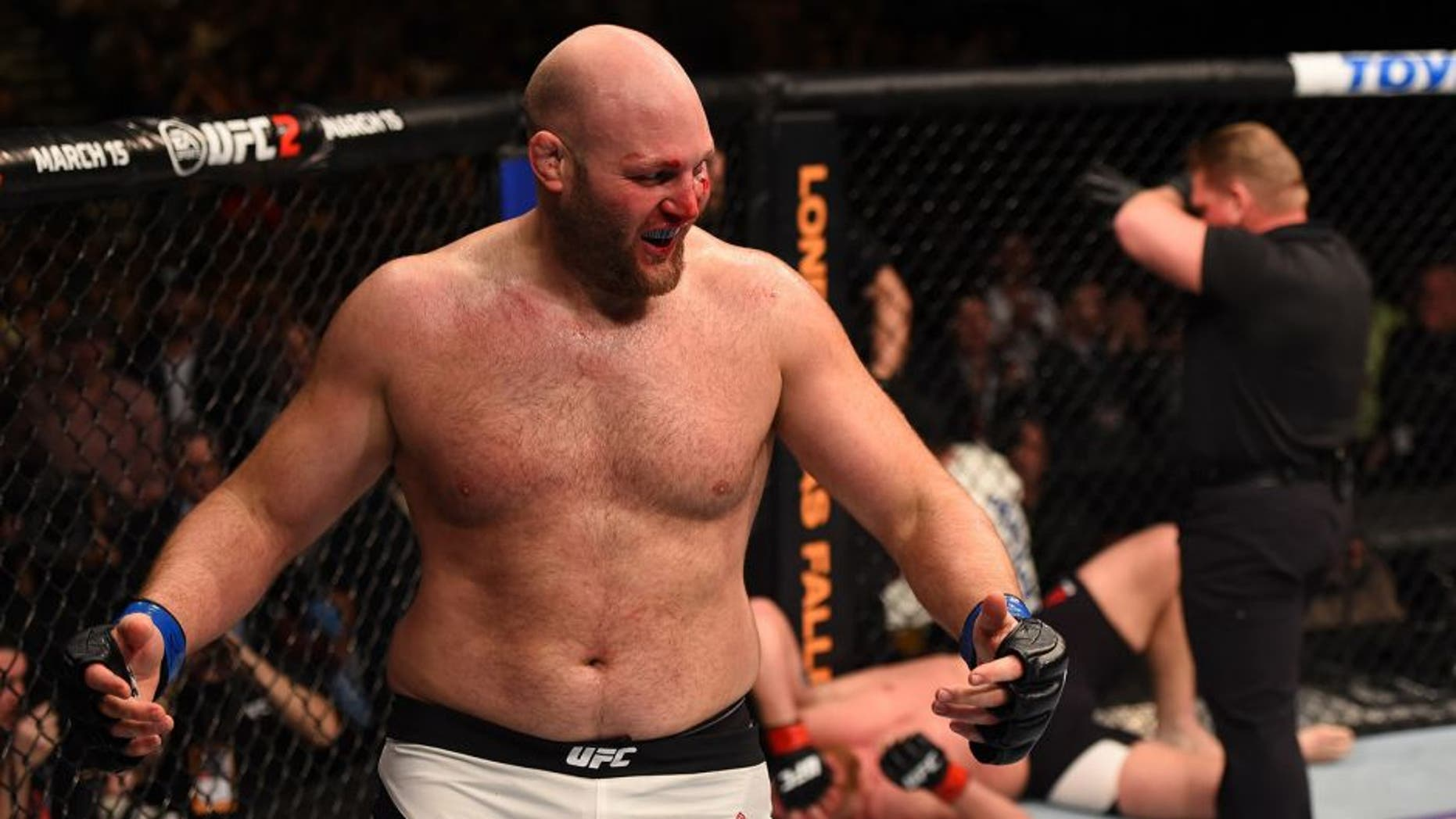 NEWARK, NJ - JANUARY 30: (L-R) Ben Rothwell celebrates his submission victory over Josh Barnett in their heavyweight bout during the UFC Fight Night event at the Prudential Center on January 30, 2016 in Newark, New Jersey. (Photo by Josh Hedges/Zuffa LLC/Zuffa LLC via Getty Images)
