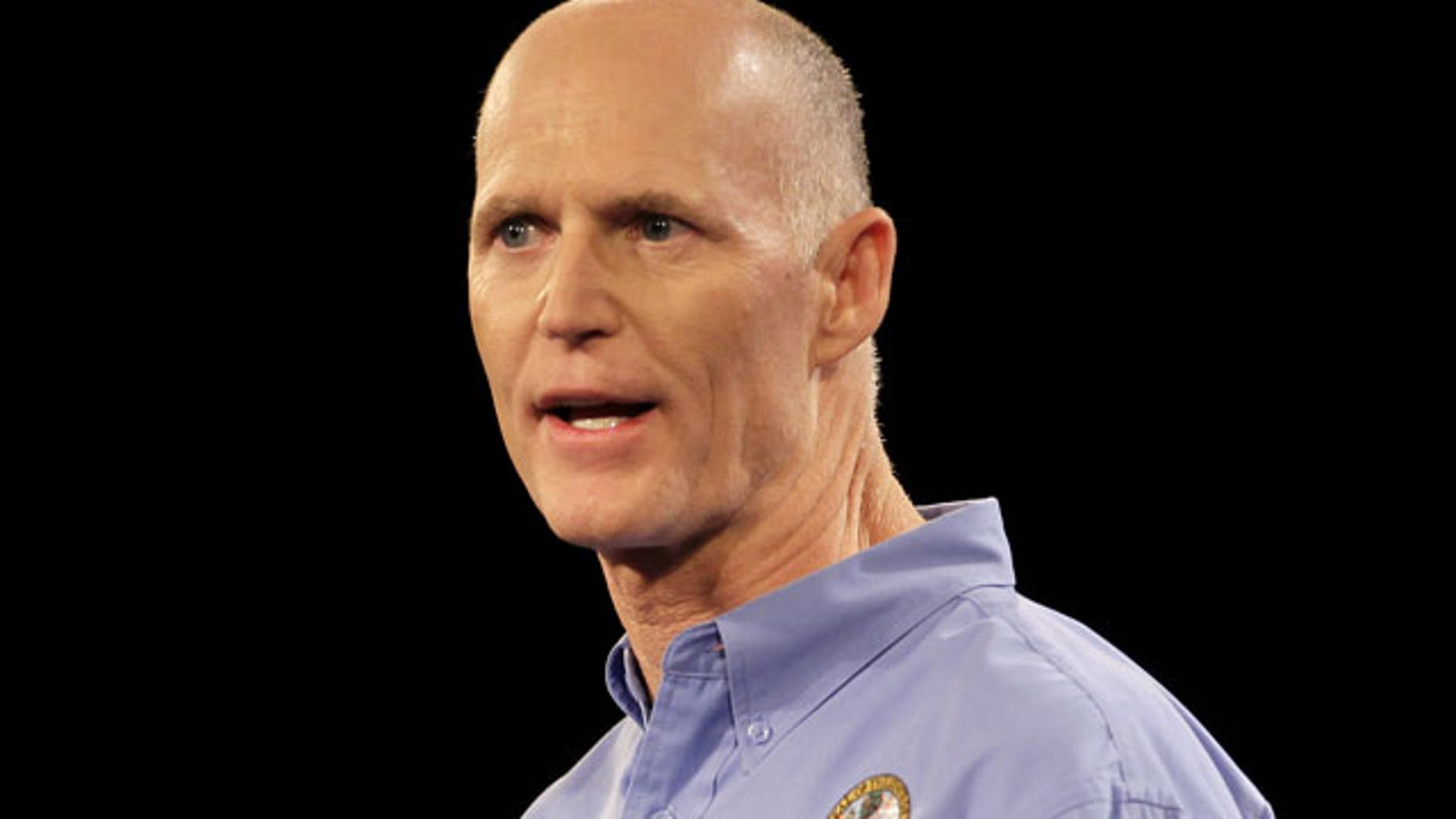 In this Saturday, Sept 24, 2011, photo, Florida Gov. Rick Scott delivers his keynote address at a Florida Republican Party Presidency 5 Convention in Orlando, Fla. A federal judge temporarily blocked Florida's new law that requires welfare applicants to pass a drug test before receiving the benefits. Gov. Rick Scott is a proponent of the law.