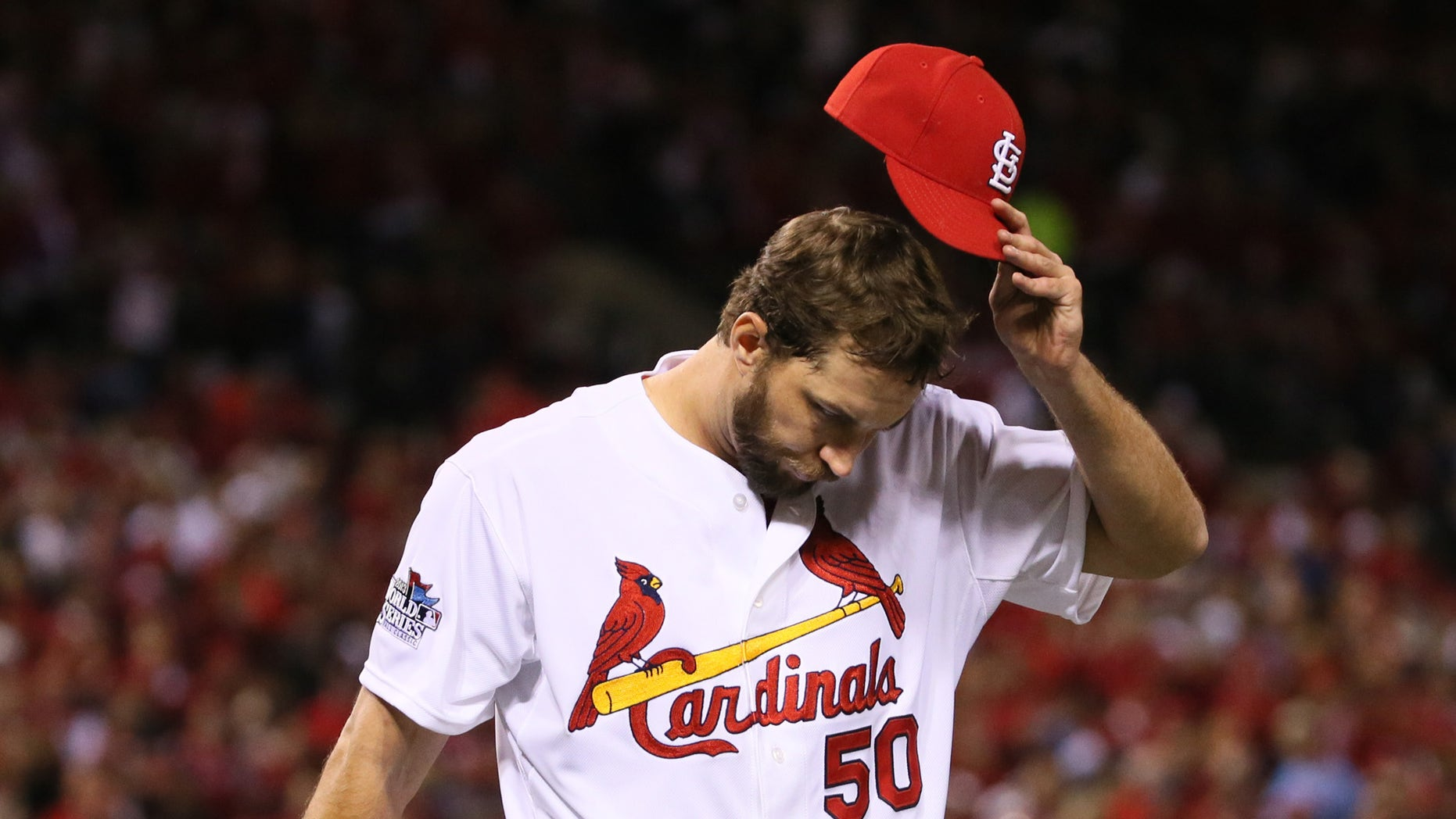 St. Louis Cardinals starting pitcher Adam Wainwright returns to the dugout after allowing two runs in the seventh inning during Game 5 of the World Series between the St. Louis Cardinals and the Boston Red Sox on Monday, Oct. 28, 2013, at Busch Stadium in St. Louis.  (AP Photo/St. Louis Post-Dispatch, Chris Lee)