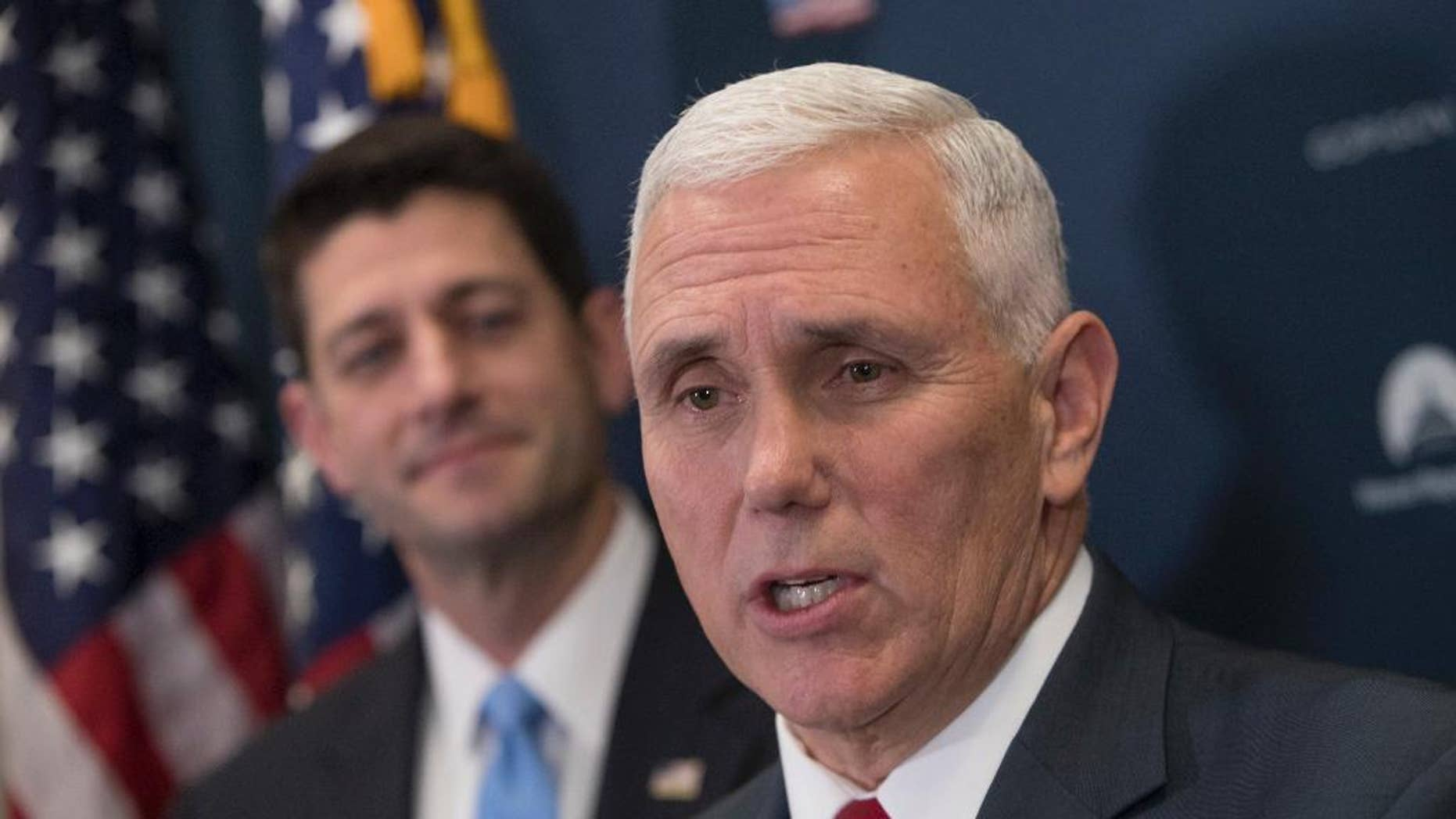 In this Jan. 4, 2017 photo, Vice President-elect Mike Pence, joined by House Speaker Paul Ryan of Wis., speaks during a news conference on Capitol Hill in Washington.  Mike Pence, who spent a dozen years in Congress before becoming Indiana's governor, is making frequent visits to Capitol Hill and promising close coordination with lawmakers as Donald Trump prepares to enter the White House.  (AP Photo/J. Scott Applewhite)