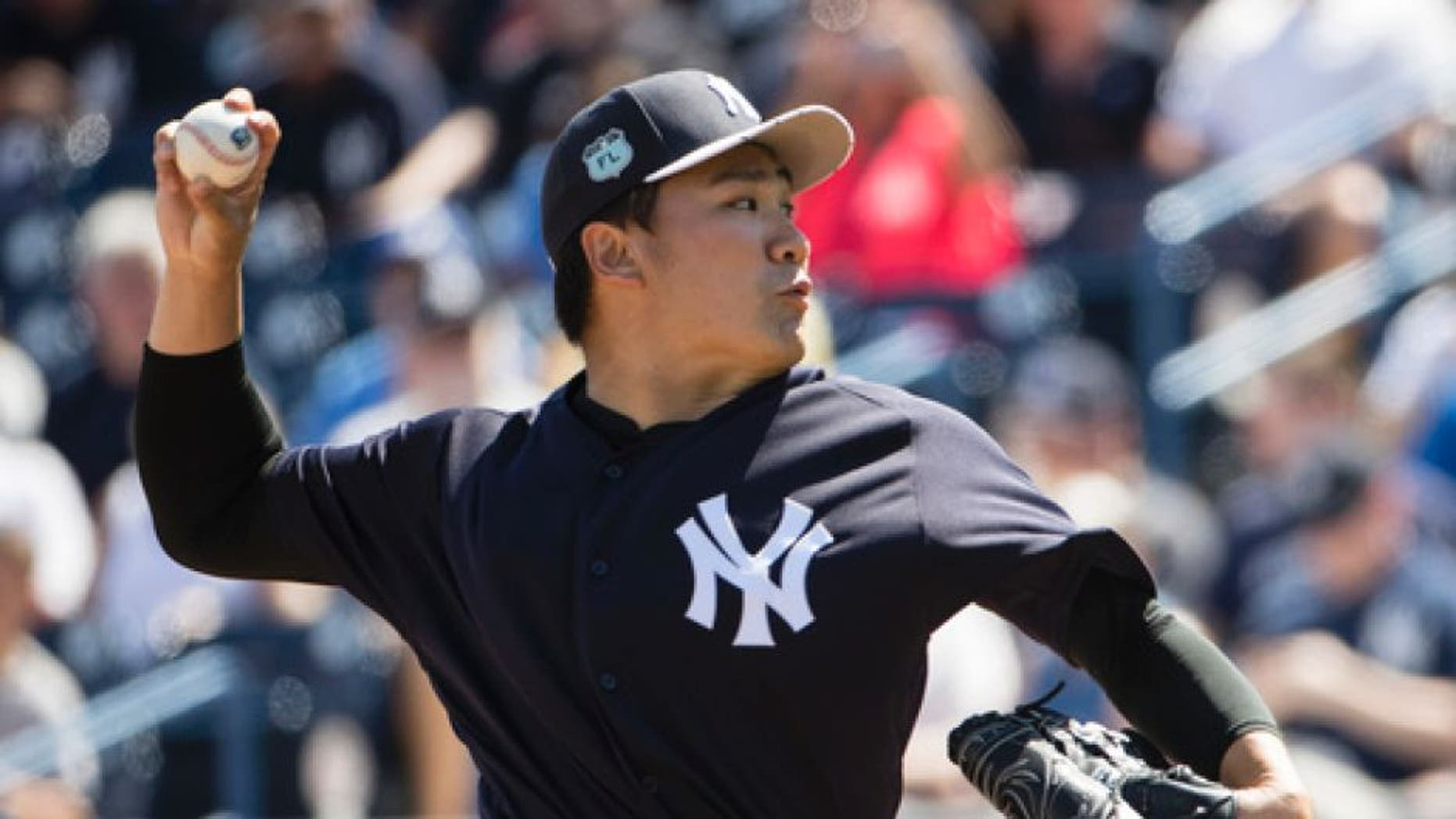 New York Yankees starting pitcher Masahiro Tanaka pitches during the first inning of a spring training baseball game against the Detroit Tigers Tuesday, Feb. 28, 2017, in Tampa, Fla. (AP Photo/Matt Rourke)
