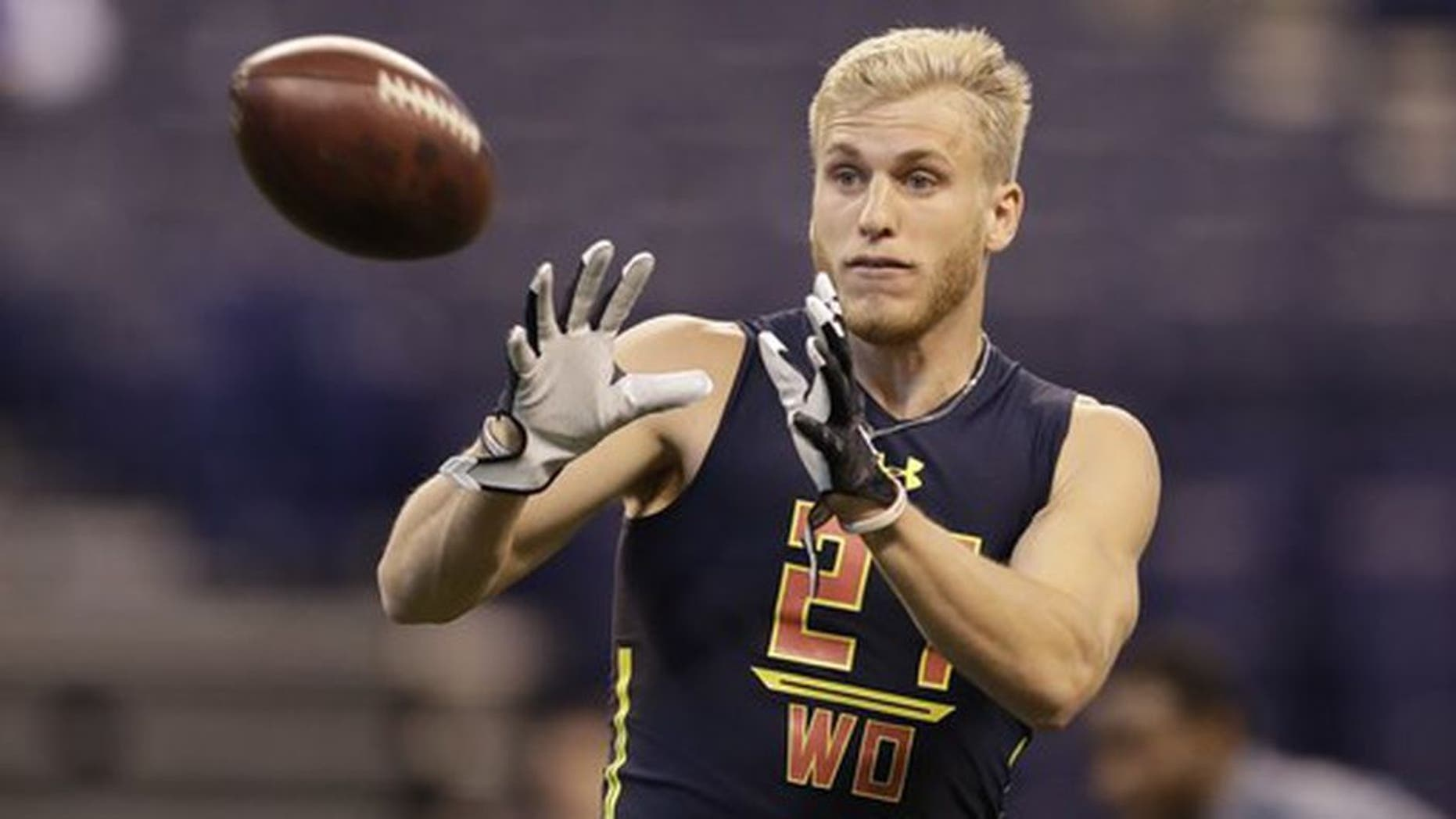 Eastern Washington wide receiver Cooper Kupp runs a drill at the NFL football scouting combine Saturday, March 4, 2017, in Indianapolis. (AP Photo/David J. Phillip)