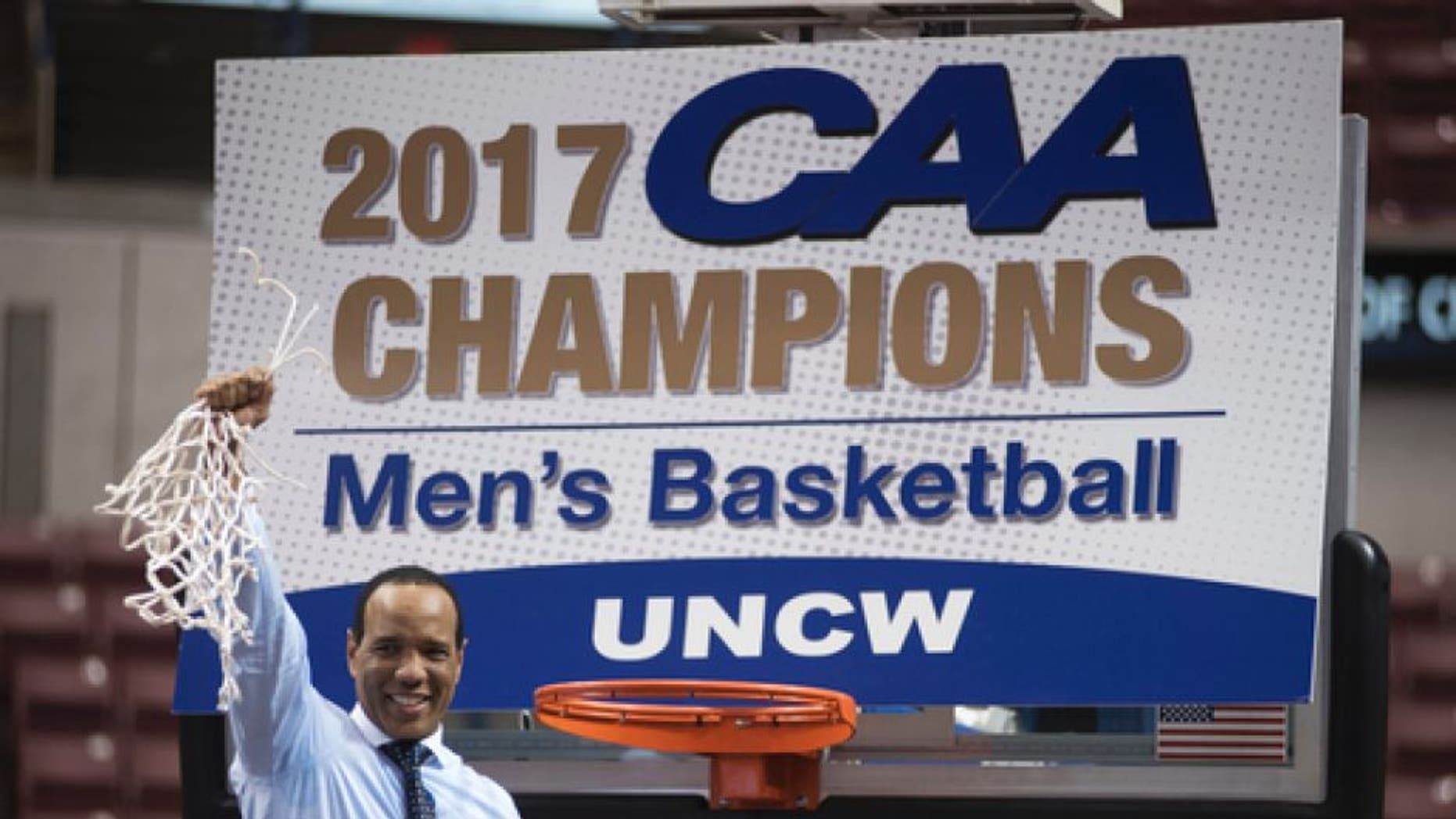 UNCW head coach Kevin Keatts cuts down the net after defeating College of Charleston 78-69 in an NCAA college basketball game in Charleston, S.C., Monday, March 6, 2017. (AP Photo/Mike Spencer)
