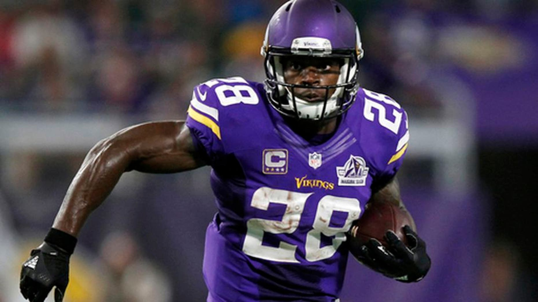 FILE - In this Sept. 18, 2016, file photo, Minnesota Vikings running back Adrian Peterson carries the ball during the team's NFL football game against the Green Bay Packers in Minneapolis. A person with knowledge of the situation tells The Associated Press that free agent running back Peterson has visited with the Seattle Seahawks. The person spoke to the AP on condition of anonymity because the details werent being made public on Sunday, March 12, when Peterson was at Seahawks headquarters. This was his first in-person meeting with a team since the Vikings declined their option on his contract for 2017 and made him a free agent for the first time. (AP Photo/Andy Clayton-King, File)