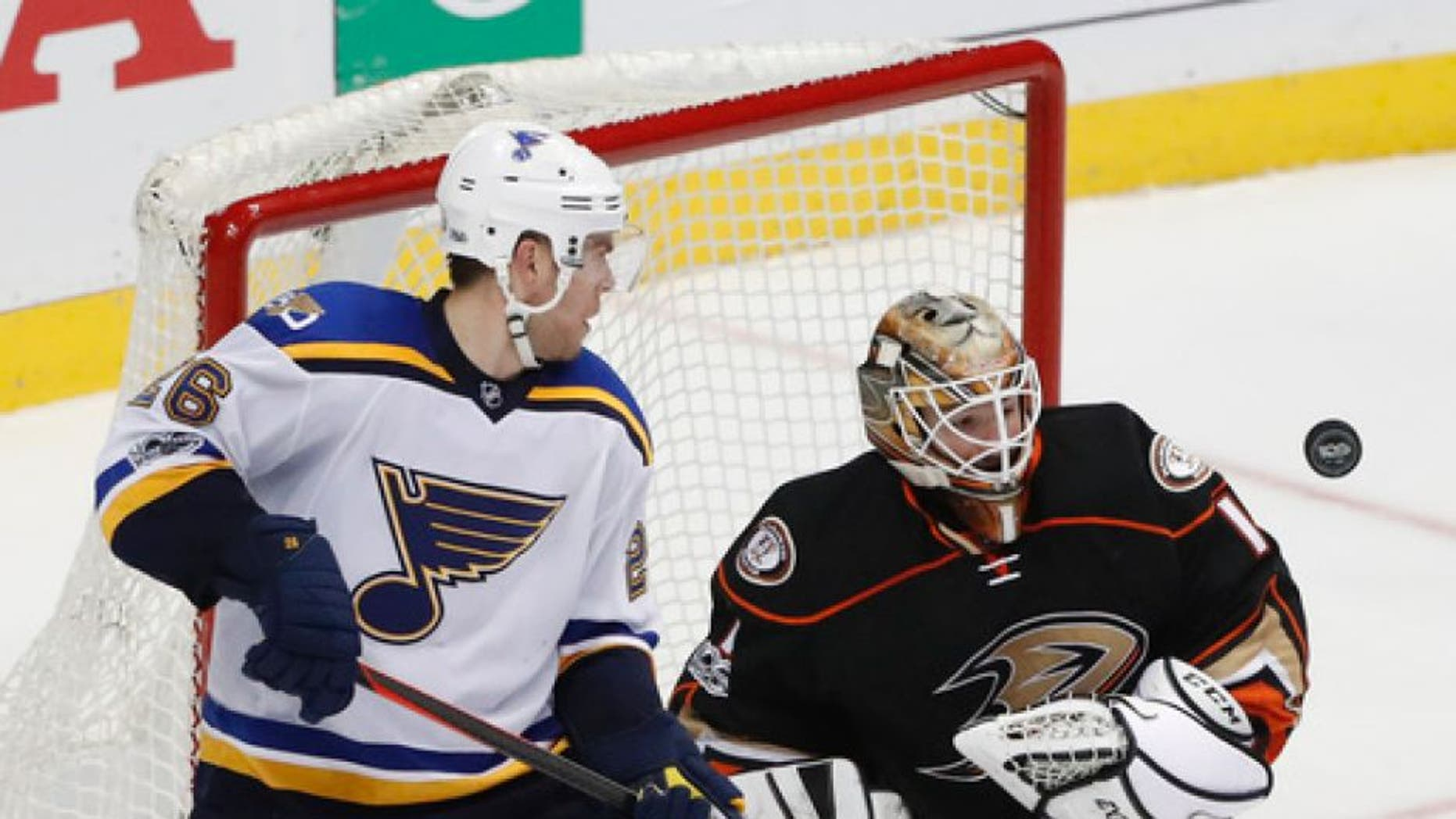 Anaheim Ducks goalie Jonathan Bernier, right, deflects the puck as St. Louis Blues' Paul Stastny watches during the third period of an NHL hockey game Wednesday, March 15, 2017, in Anaheim, Calif. The Ducks won 2-1. (AP Photo/Jae C. Hong)