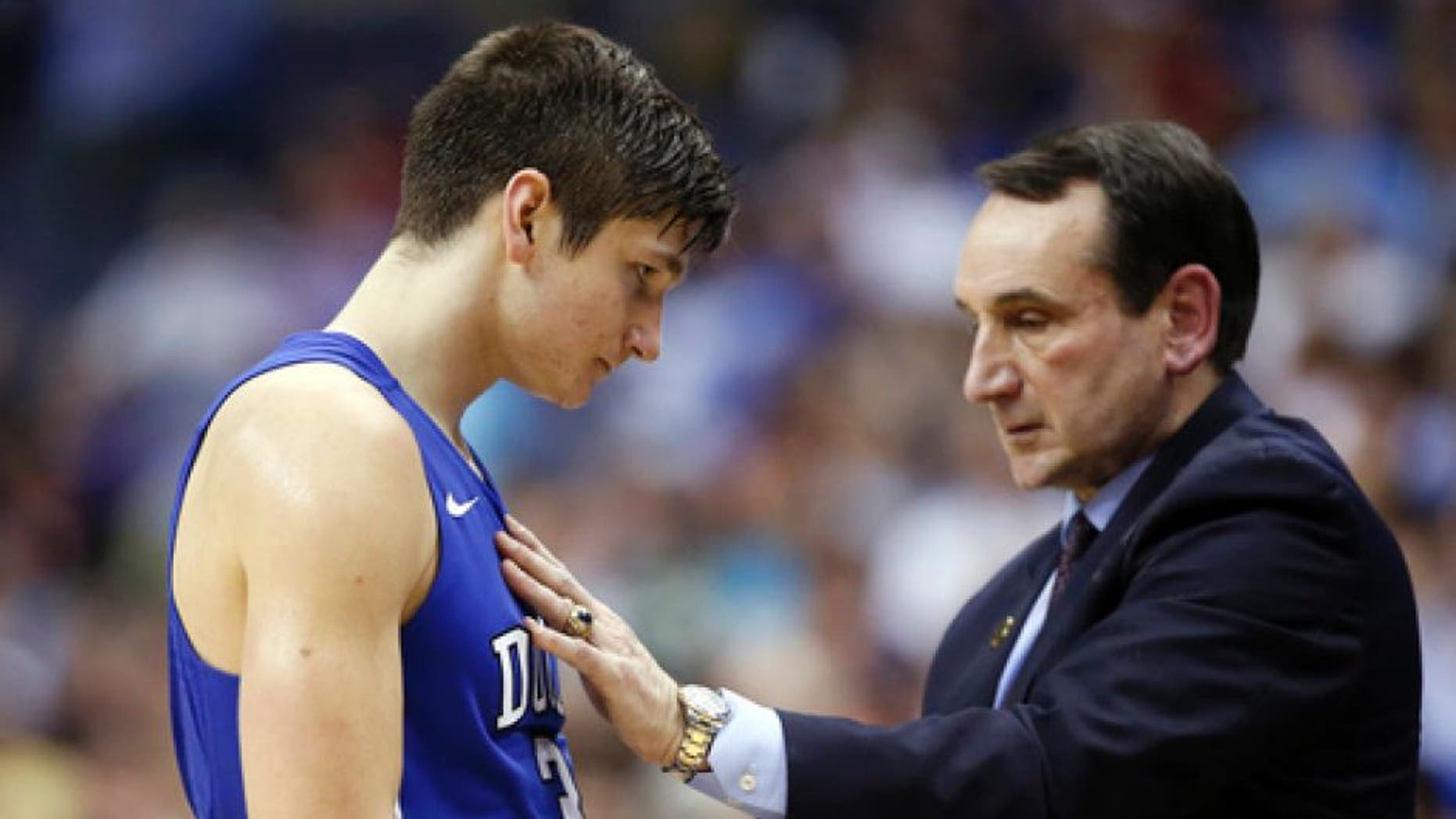 """FILE - In this March 10, 2016, file photo, Duke guard Grayson Allen (3) talks with coach Mike Krzyzewski during the team's NCAA college basketball game against Notre Dame in the Atlantic Coast Conference tournament in Washington. Krzyzewski handed down an """"indefinite"""" suspension to Allen because Allen couldn't stop tripping opponents. The suspension turned out to last one game. (AP Photo/Alex Brandon, File)"""