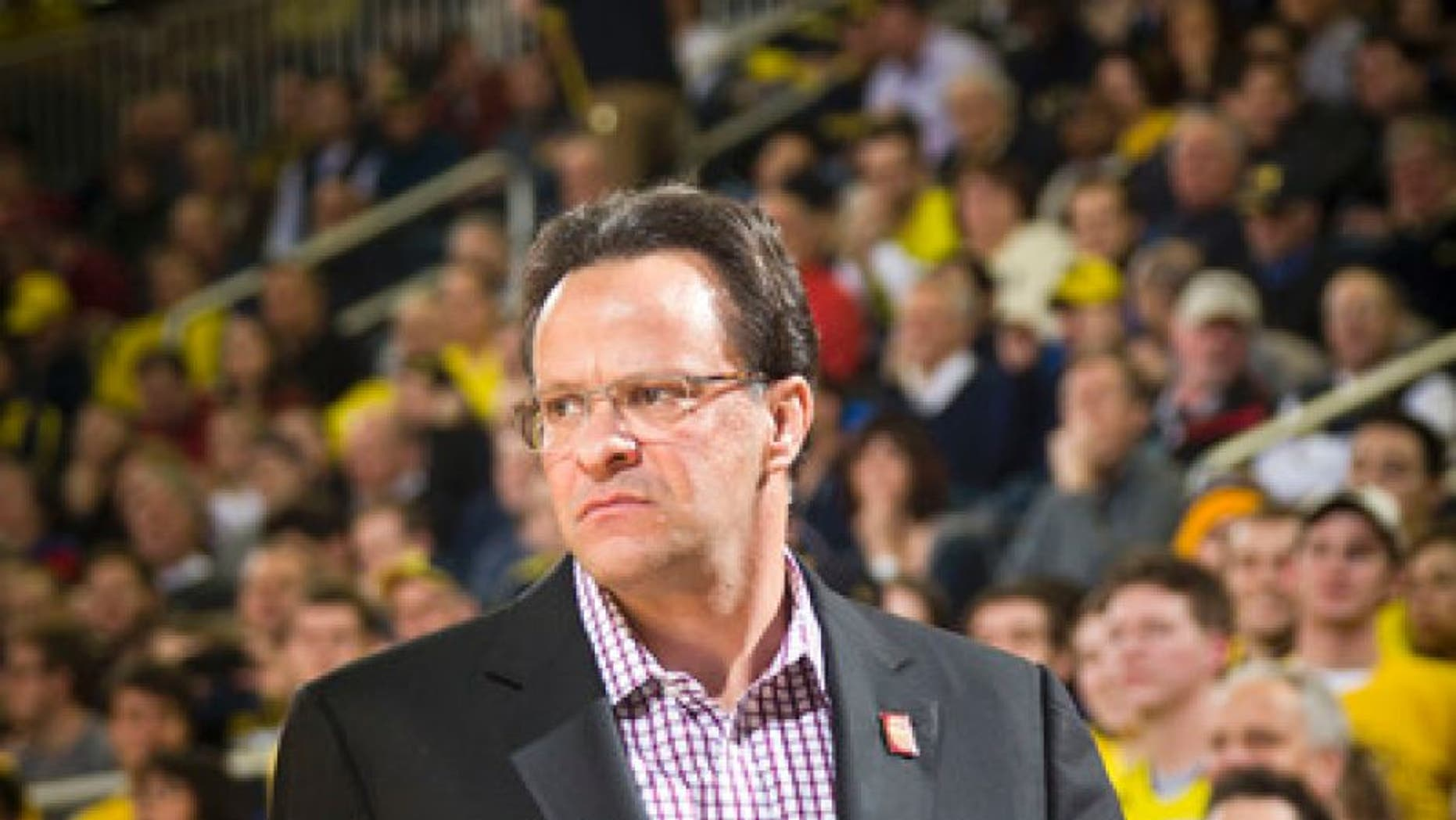 FILE - In this Feb. 2, 2016, file photo, Indiana head coach Tom Crean walks the court beside his bench in the first half of an NCAA college basketball game against Michigan at Crisler Center in Ann Arbor, Mich. Crean has been fired after five seasons. Athletic director Fred Glass announced the decision Thursday, March 16, 2017, as the NCAA Tournament was beginning. (AP Photo/Tony Ding, File)