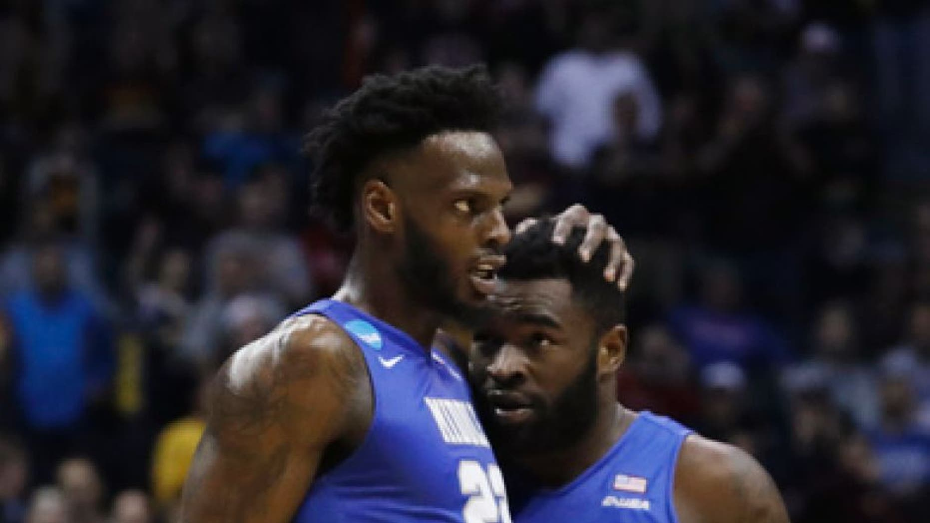 Middle Tennessee State's JaCorey Williams (22) and Giddy Potts (20) celebrate during the second half of an NCAA college basketball tournament first round game against Minnesota Thursday, March 16, 2017, in Milwaukee. Middle Tennessee State won 81-72. (AP Photo/Morry Gash)