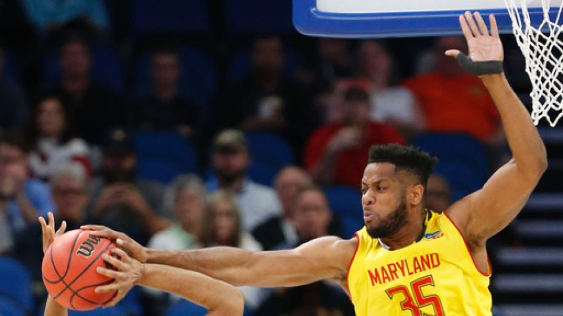 Maryland forward Damonte Dodd (35) blocks a shot from Xavier guard Trevon Bluiett (5) during the first half of the first round of the NCAA college basketball tournament, Thursday, March 16, 2017 in Orlando, Fla. (AP Photo/Wilfredo Lee)