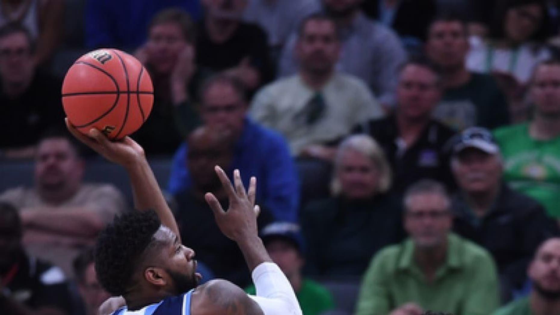 SACRAMENTO, CA - MARCH 17: Hassan Martin #12 of the Rhode Island Rams attempts a shot against the Creighton Bluejays during the first round of the 2017 NCAA Men's Basketball Tournament at Golden 1 Center on March 17, 2017 in Sacramento, California. (Photo by Thearon W. Henderson/Getty Images)