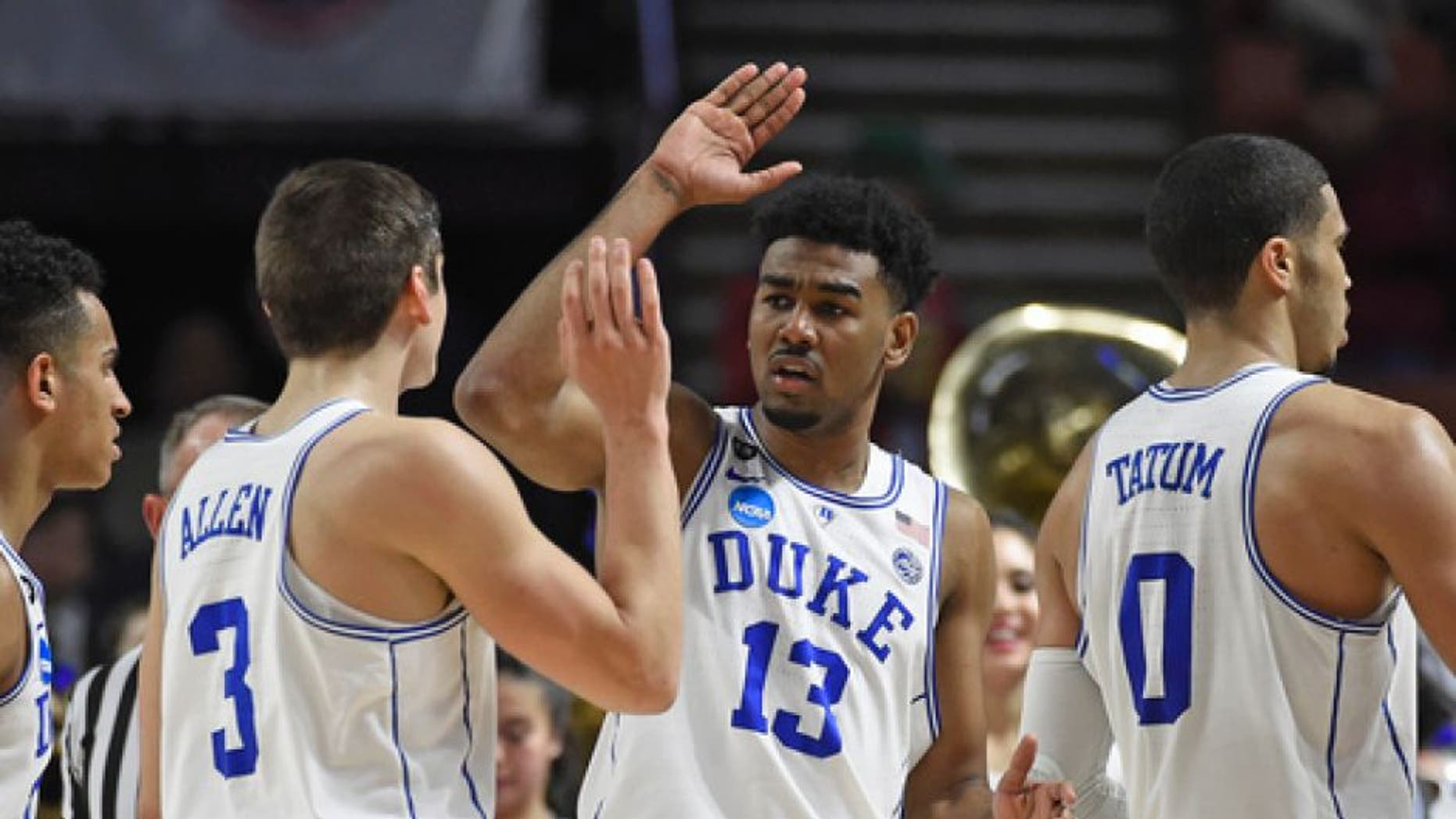 Duke's Matt Jones (13) celebrates with Grayson Allen (3) during the first half against Troy in a first-round game of the NCAA men's college basketball tournament in Greenville, S.C., Friday, March 17, 2017. (AP Photo/Rainier Ehrhardt)