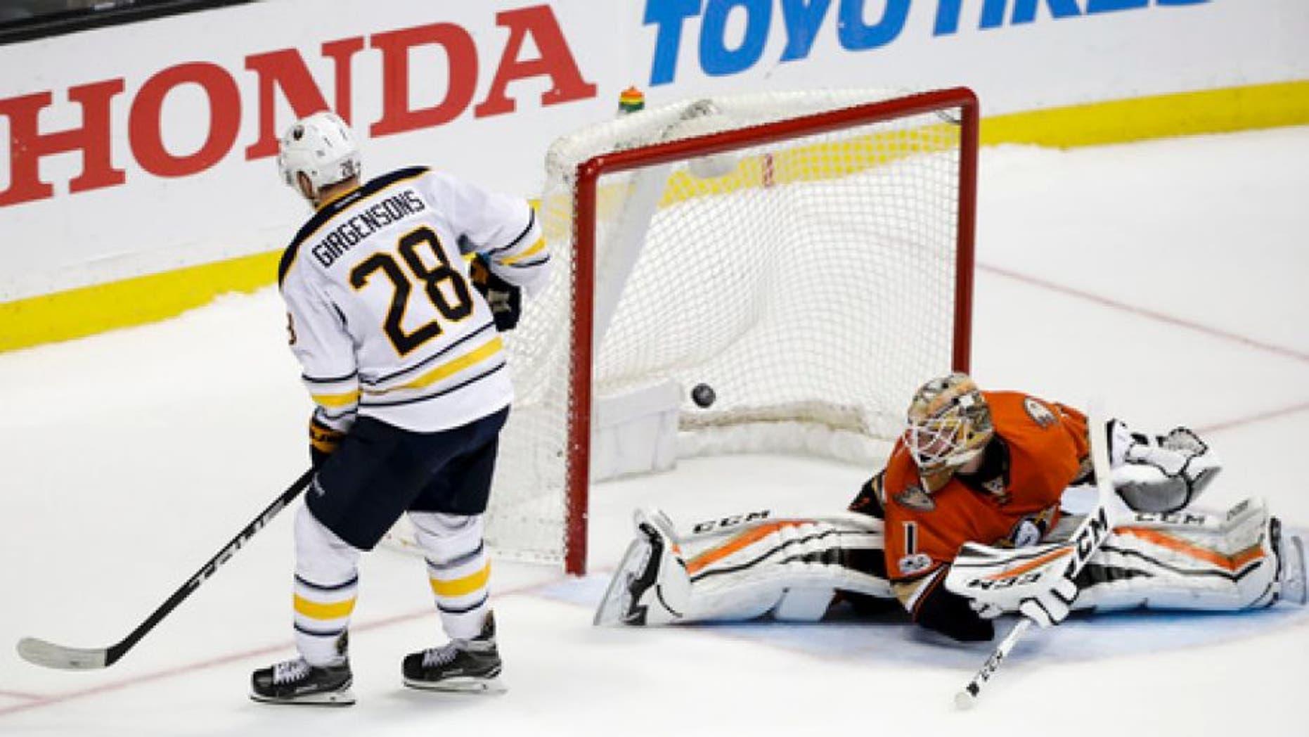 Buffalo Sabres' Zemgus Girgensons, left, of Latvia, scores against Anaheim Ducks goalie Jonathan Bernier during the shootout of an NHL hockey game Friday, March 17, 2017, in Anaheim, Calif. The Sabres won 2-1. (AP Photo/Jae C. Hong)