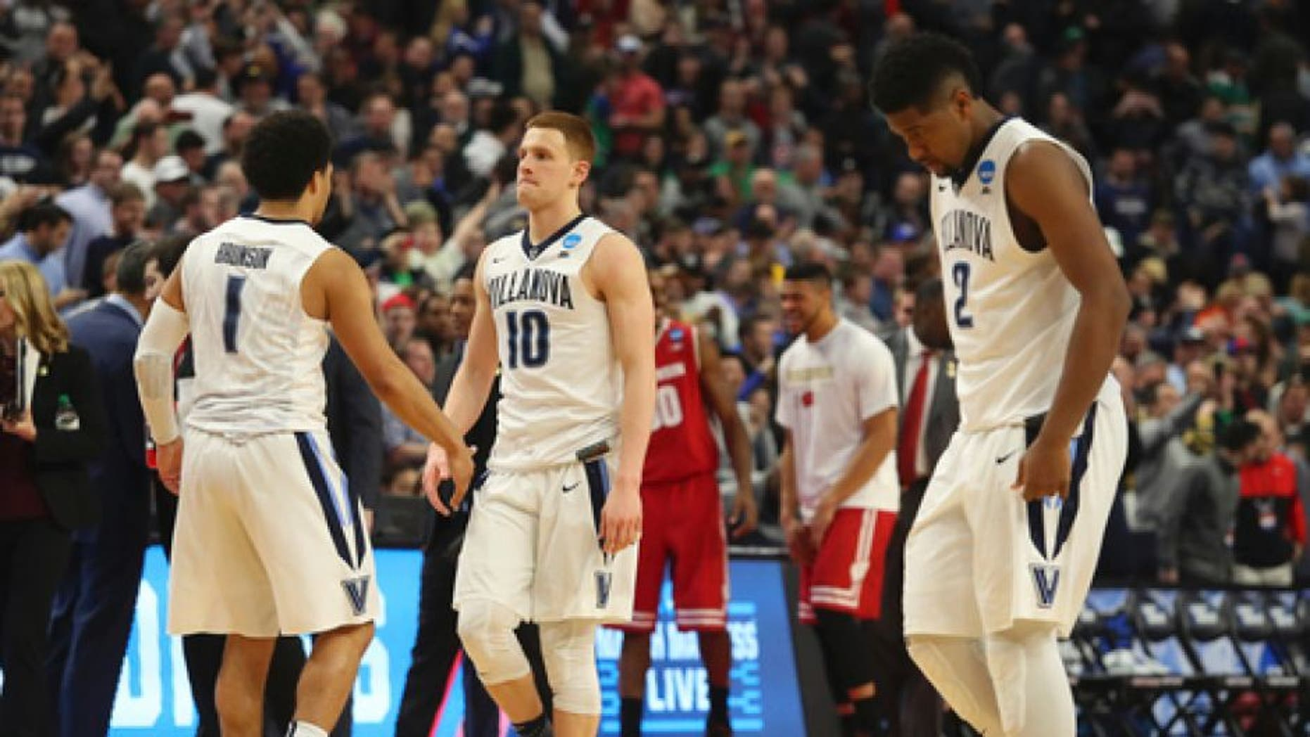 Villanova guard Jalen Brunson (1), guard Donte DiVincenzo (10) and forward Kris Jenkins (2) leave the court after their loss to Wisconsin in a second-round men's college basketball game in the NCAA Tournament, Saturday, March 18, 2017, in Buffalo, N.Y. (AP Photo/Bill Wippert)