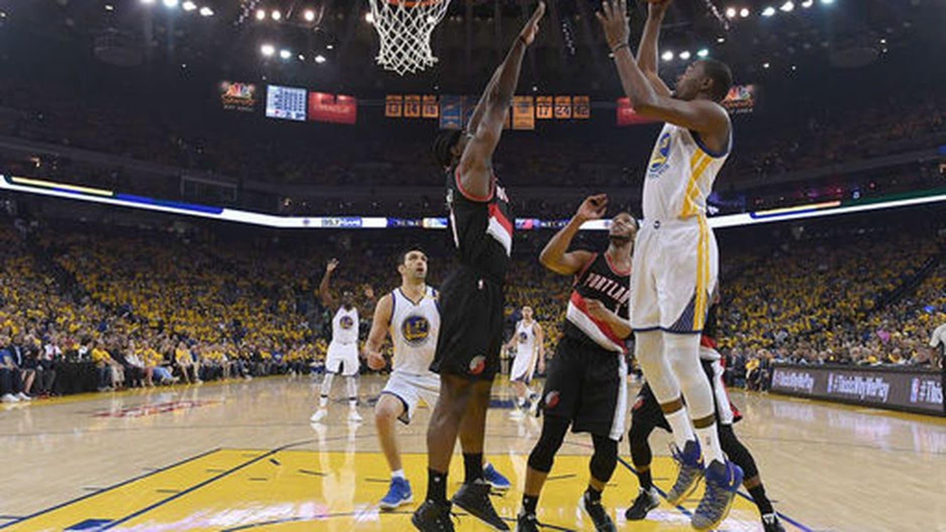 OAKLAND, CA - APRIL 16: Kevin Durant #35 of the Golden State Warriors goes up for a layup over Noah Vonleh #21 of the Portland Trail Blazers in the first quarter during Game One of the first round of the 2017 NBA Playoffs at ORACLE Arena on April 16, 2017 in Oakland, California. NOTE TO USER: User expressly acknowledges and agrees that, by downloading and or using this photograph, User is consenting to the terms and conditions of the Getty Images License Agreement. (Photo by Thearon W. Henderson/Getty Images)