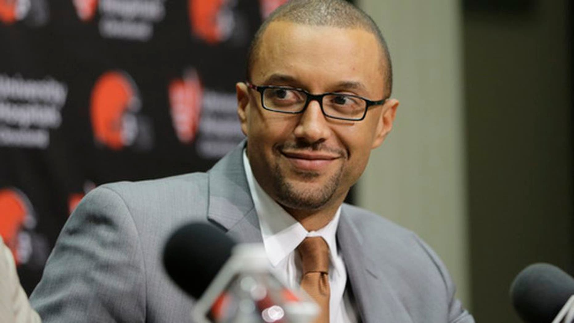 """FILE - In this Jan. 13, 2016, file photo, Cleveland Browns Executive Vice President of Football Operations, Sashi Brown, addresses the media during a news conference in Berea, Ohio. The Browns are inclined to keep the No. 1 overall pick in next weeks NFL draft despite getting offers for it. Sashi Brown said Wednesday, April 19, 2017, that the Browns feel really good about drafting No. 1."""" (AP Photo/Tony Dejak, File)"""