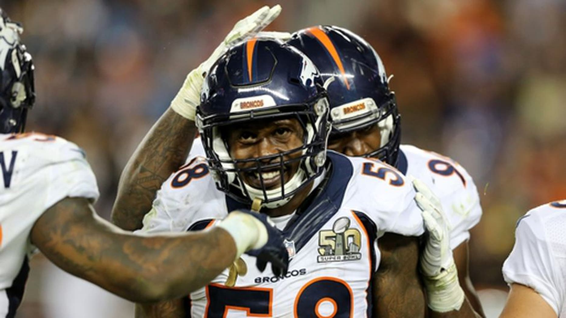 FILE - In this Feb. 7, 2016, file photo, Denver Broncos' Von Miller (58) celebrates with teammates in the fourth quarter of the NFL Super Bowl 50 football game in Santa Clara, Calif. Von Miller has his Super Bowl 50 helmet back. The FBI retrieved his helmet from Mexican authorities who also recovered Tom Brady's two Super Bowl jerseys in Mexico City last month. Special agents Brian Schmitt, Melissa Tallman and Clint Judd delivered the helmet to Miller at the UC Heath Center on Wednesday, April 19, 2017. (AP Photo/Gregory Payan, File)