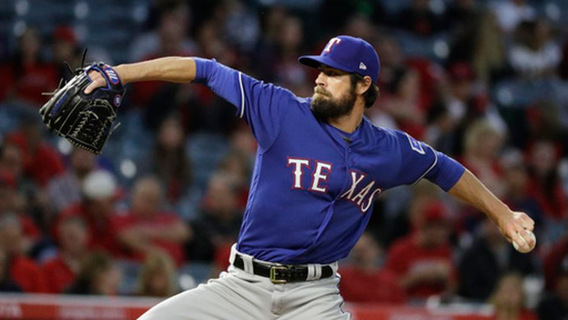 Texas Rangers starting pitcher Cole Hamels throws against the Los Angeles Angels during the first inning of a baseball game, Tuesday, April 11, 2017, in Anaheim, Calif. Cole Hamels makes his fourth start this season for Texas on Friday, April 21,, and the Rangers left-hander is still looking for his first decision when the Rangers host Kansas City. (AP Photo/Jae C. Hong)
