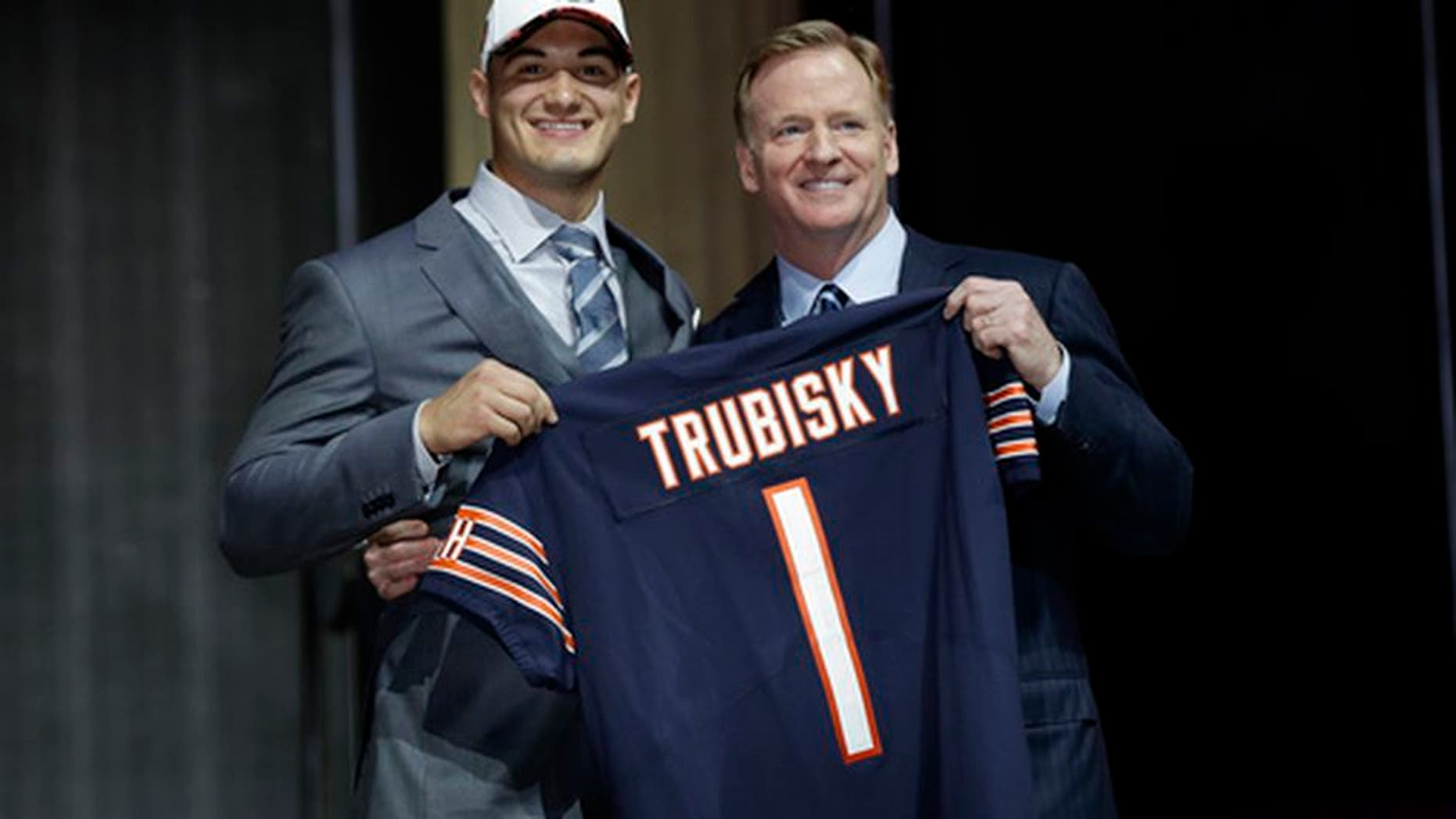 North Carolina's Mitch Trubisky, left, poses with NFL commissioner Roger Goodell after being selected by the Chicago Bears during the first round of the 2017 NFL football draft, Thursday, April 27, 2017, in Philadelphia. (AP Photo/Matt Rourke)