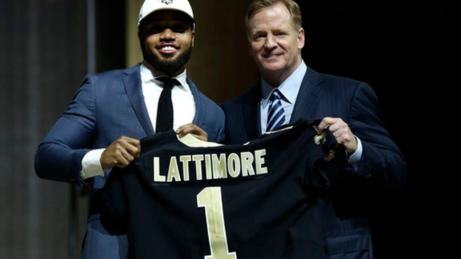 Ohio State's Marshon Lattimore, left, poses with NFL commissioner Roger Goodell after being selected by the New Orleans Saints during the first round of the 2017 NFL football draft, Thursday, April 27, 2017, in Philadelphia. (AP Photo/Matt Rourke)