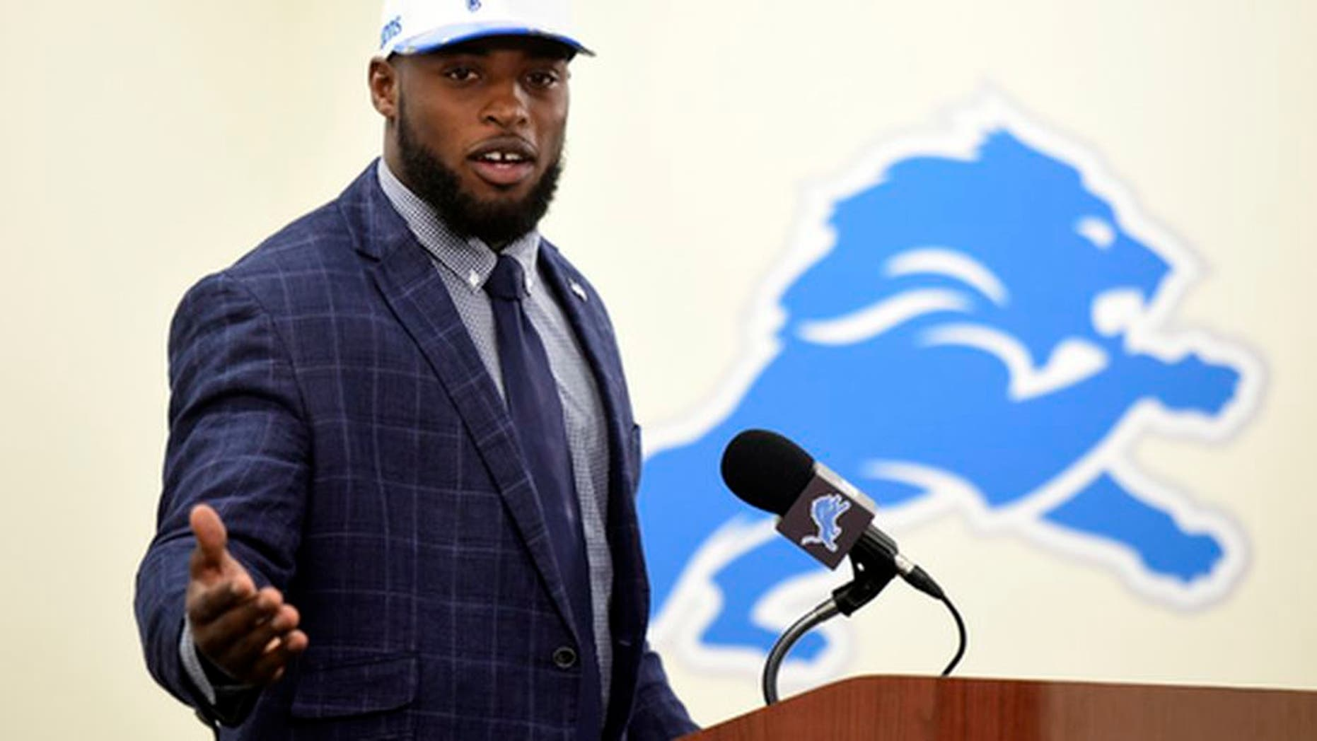 Jarrad Davis, the Detroit Lions first round draft pick, is introduced at an NFL football press conference, Friday, April 28, 2017, in Allen Park, Mich. Davis, a linebacker at Florida, was selected 21st overall. (Daniel Mears/Detroit News via AP)