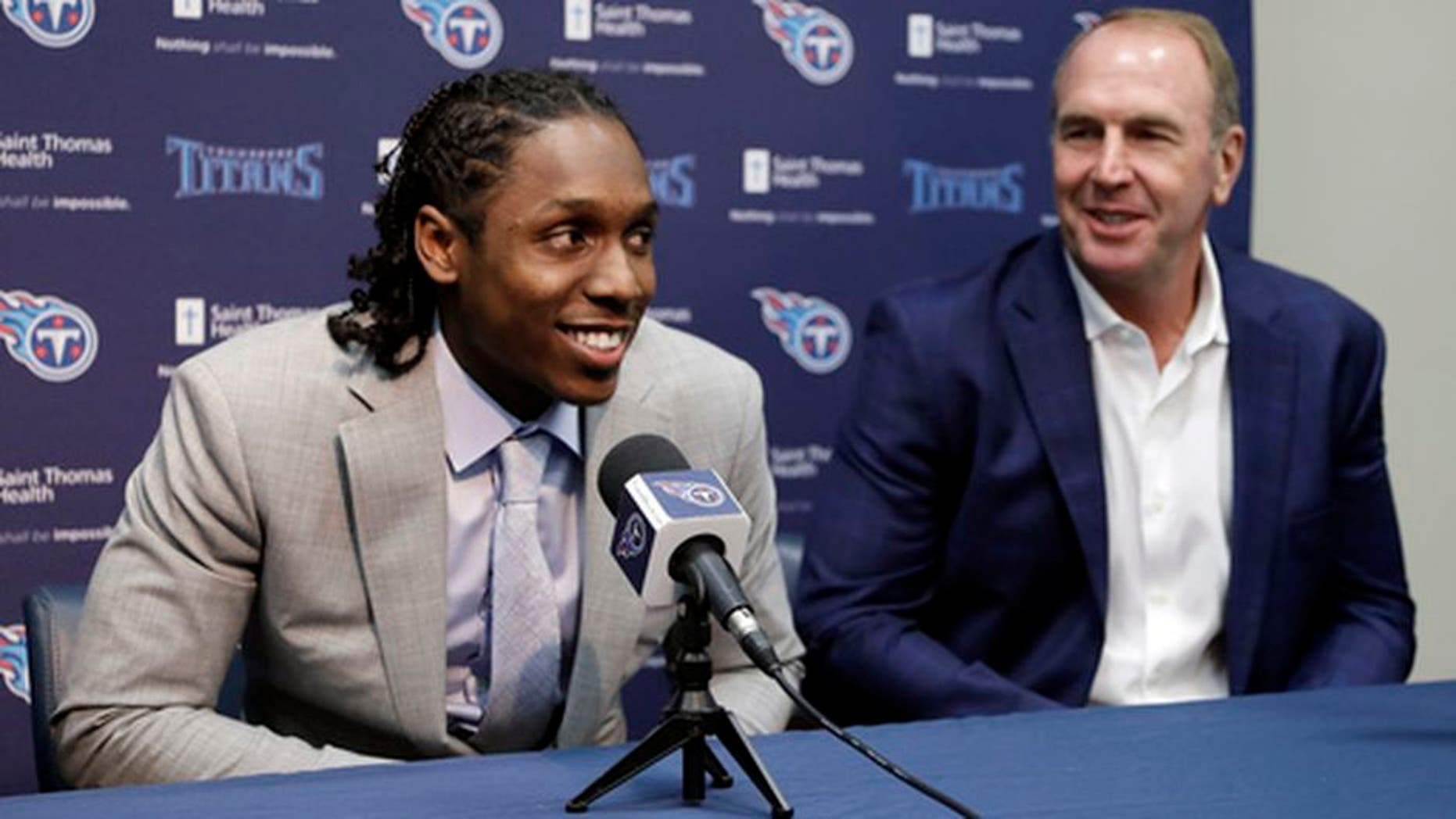 Southern California defensive back Adoree' Jackson, left, answers questions as he sits with Tennessee Titans coach Mike Mularkey during a news conference Friday, April 28, 2017, in Nashville, Tenn. Jackson is the NFL football team's second pick in the draft. (AP Photo/Mark Humphrey)