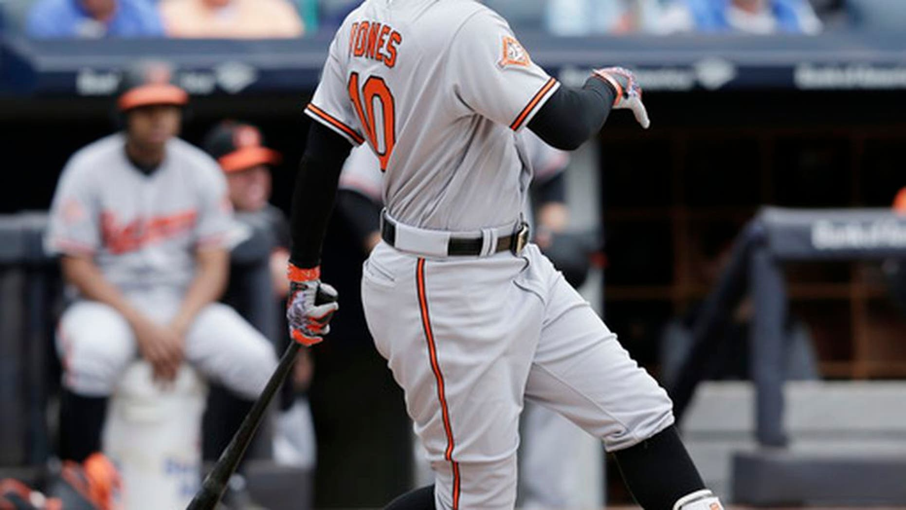Baltimore Orioles' Adam Jones hits an RBI-single during the third inning of a baseball game against the New York Yankees at Yankee Stadium, Sunday, April 30, 2017, in New York. (AP Photo/Seth Wenig)