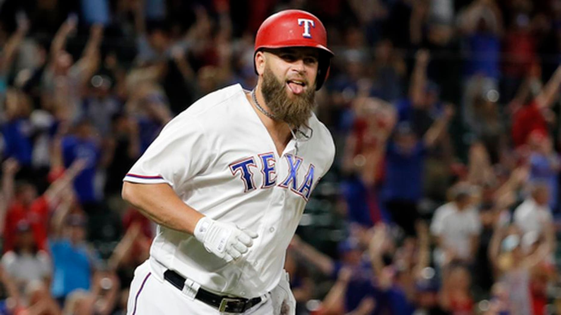 Texas Rangers' Mike Napoli celebrates as he runs the bases after hitting a game-winning three-run home run off San Diego Padres reliever Brandon Maurer during the ninth inning of a baseball game, Thursday, May 11, 2017, in Arlington, Texas. The Rangers won 5-2. (AP Photo/Tony Gutierrez)