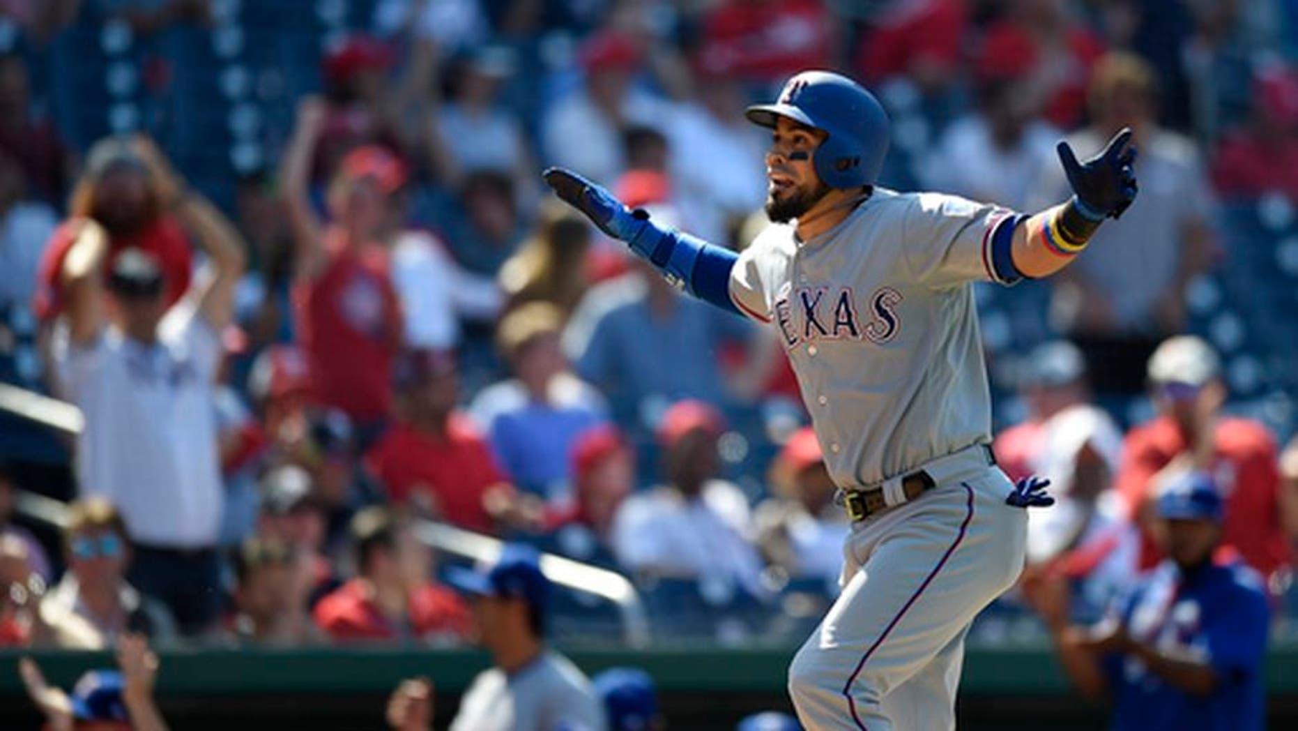 Texas Rangers' Robinson Chirinos reacts as he heads home after he hit a three-run home run during the 11th inning of a baseball game against the Washington Nationals, Saturday, June 10, 2017, in Washington. The Rangers won 6-3 in 11 innings. (AP Photo/Nick Wass)