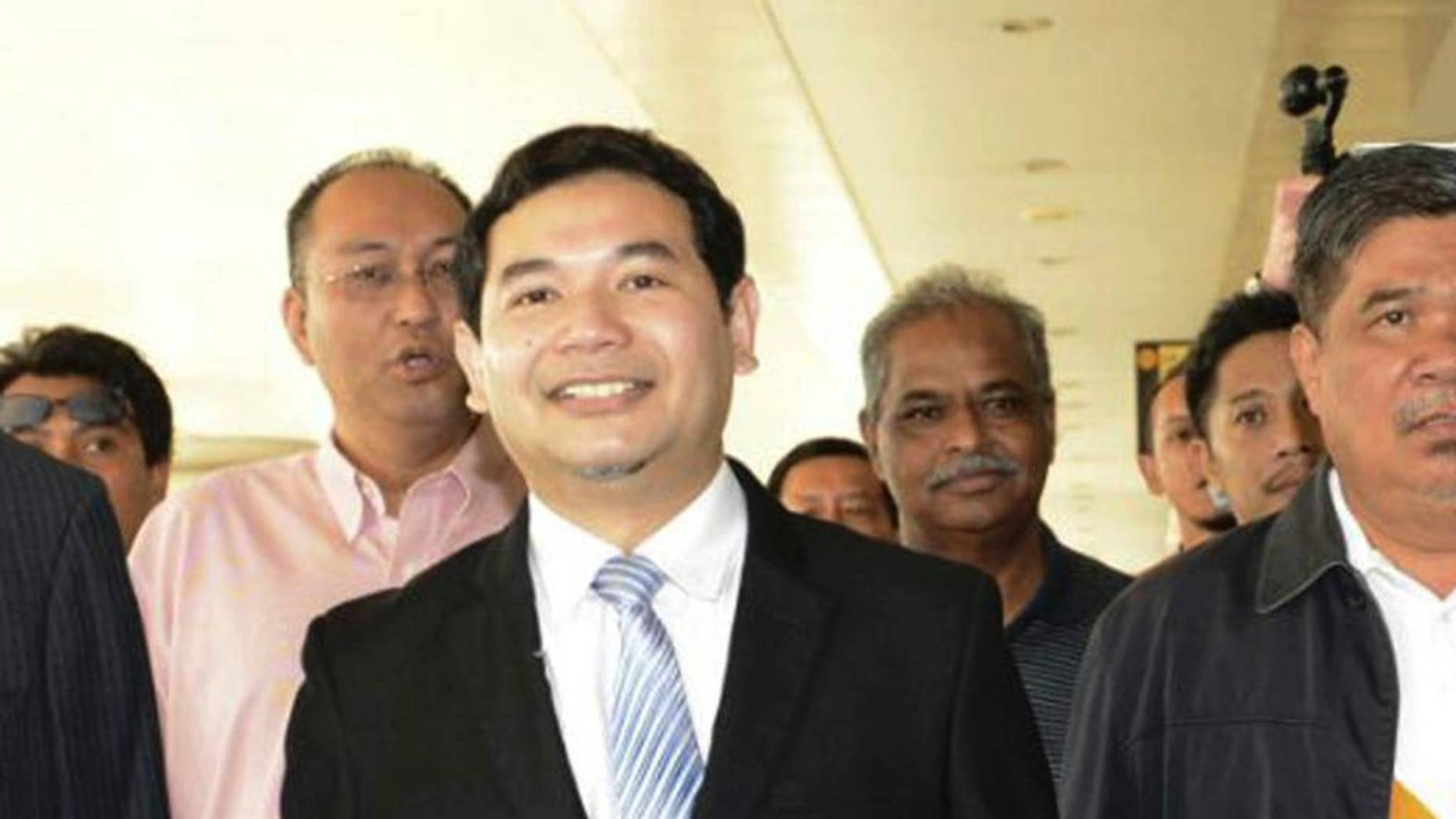 Malaysia's People's Justice Party Vice President Rafizi Ramli arrives at court in Kuala Lumpur, Malaysia, Monday, Nov. 14, 2016. The prominent Malaysian opposition lawmaker, who has a reputation as a whistle blower, has been sentenced to 18 months in jail for releasing a classified document on a controversial state investment fund, founded by Prime Minister Najib Razak. (AP Photo)