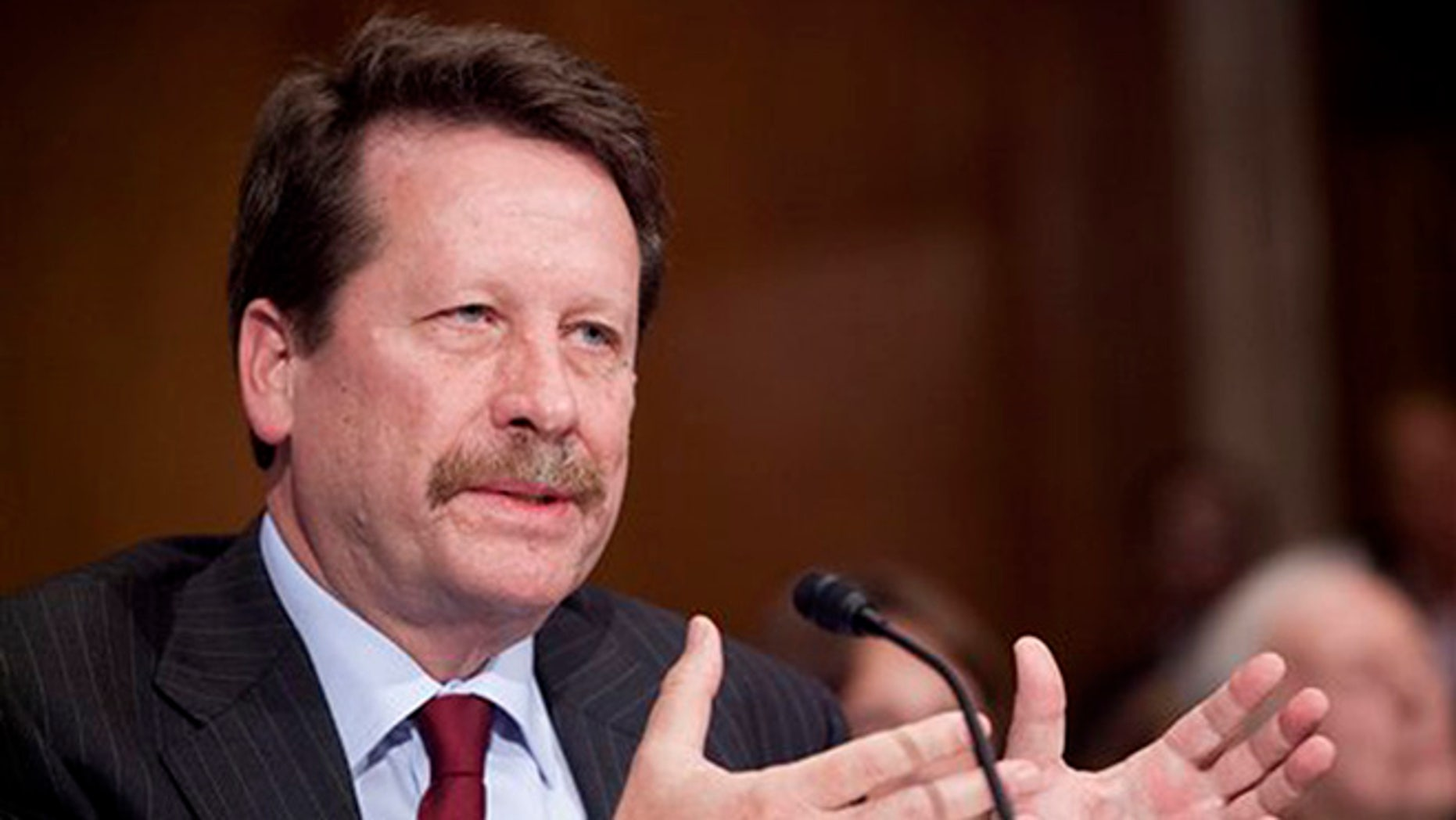 FILE - In this Nov. 17, 2015 file photo, Dr. Robert Califf, President Barack Obama's nominee to lead the Food and Drug Administration (FDA), testifies on Capitol Hill in Washington. The Senate has confirmed Califf to be commissioner of the FDA. Senators voted 89-4 Wednesday, Feb. 24, 2016, to confirm Califf after a handful of Democrats delayed action in a protest over the agency's inaction on the abuse of opioid painkillers.  (AP Photo/Pablo Martinez Monsivais, File)