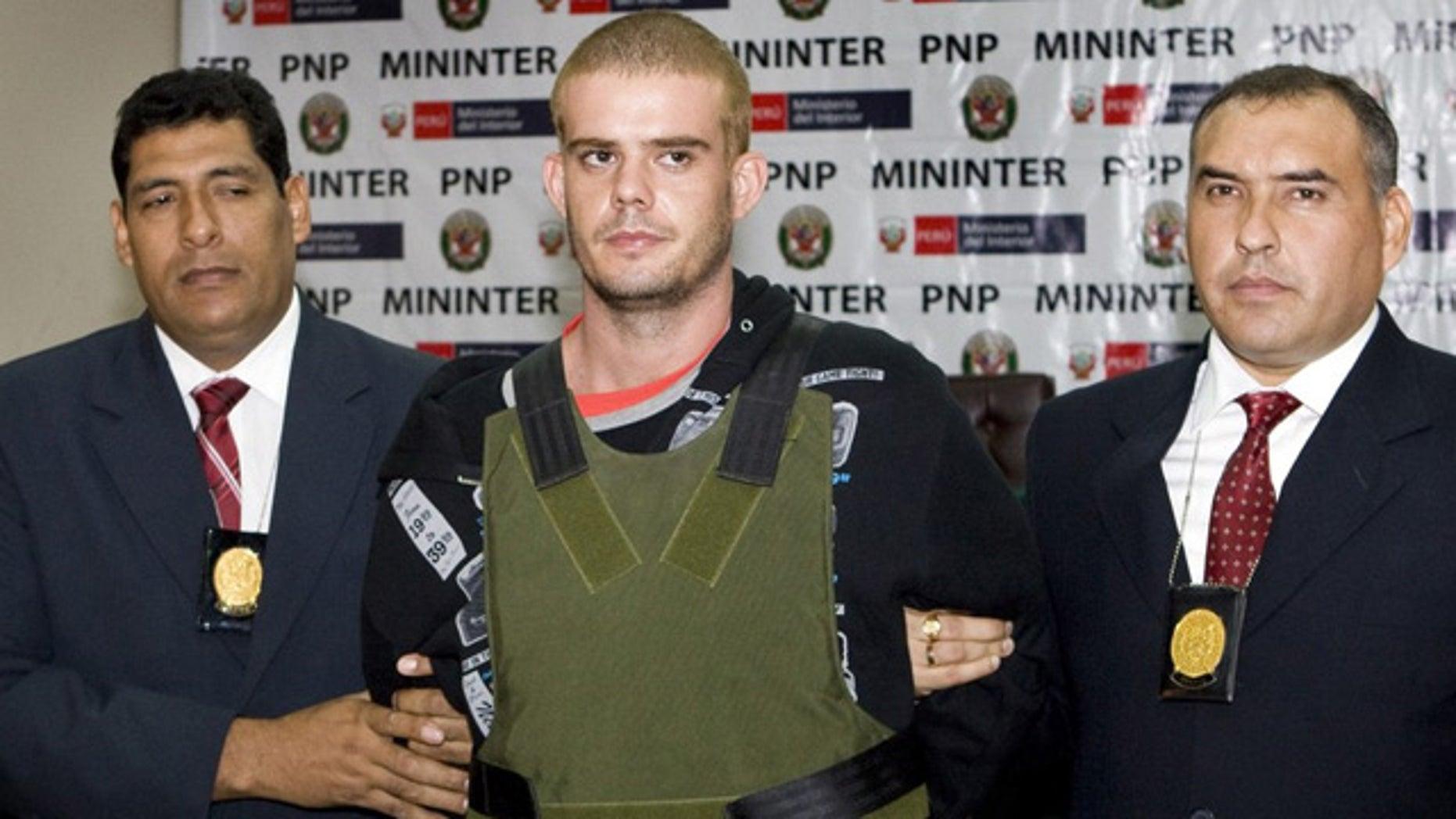 June 5: Joran van der Sloot is escorted by Peruvian police as he arrives at their offices in Lima.