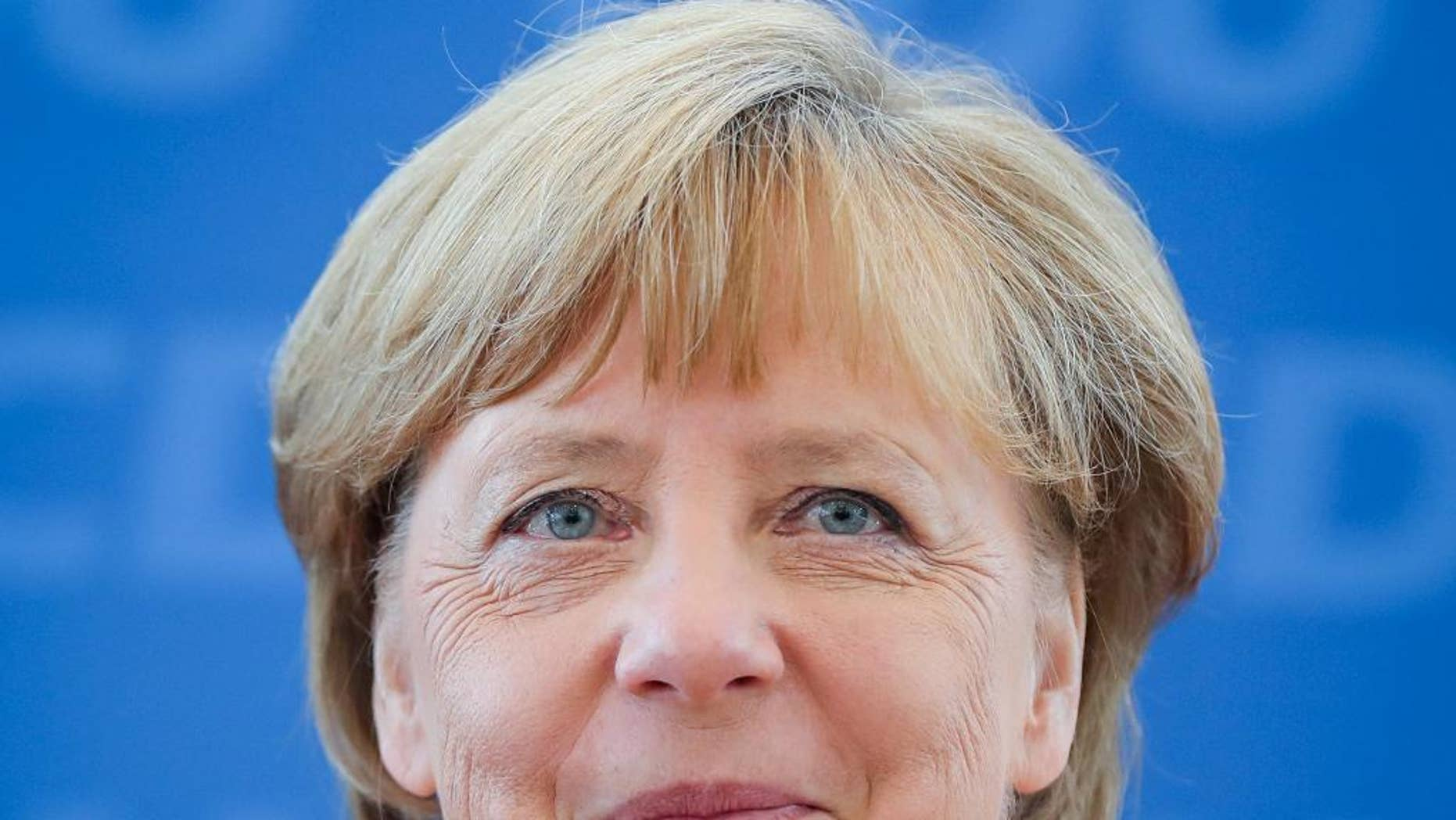 German chancellor Angela Merkel  meets party officials at the headquarters  of her Christian Democrats  in Berlin, Germany,  Monday, Aug. 15, 2016. (Kay Nietfeld/dpa via AP)