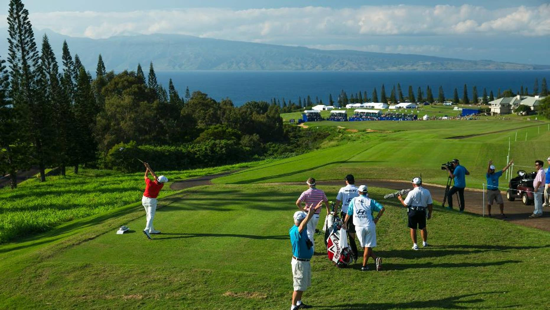 Sang-Moon Bae, of South Korea, drives on the 18th tee during the third round of the Tournament of Champions golf tournament, Sunday, Jan. 11, 2015, in Kapalua, Hawaii.  (AP Photo/Marco Garcia)