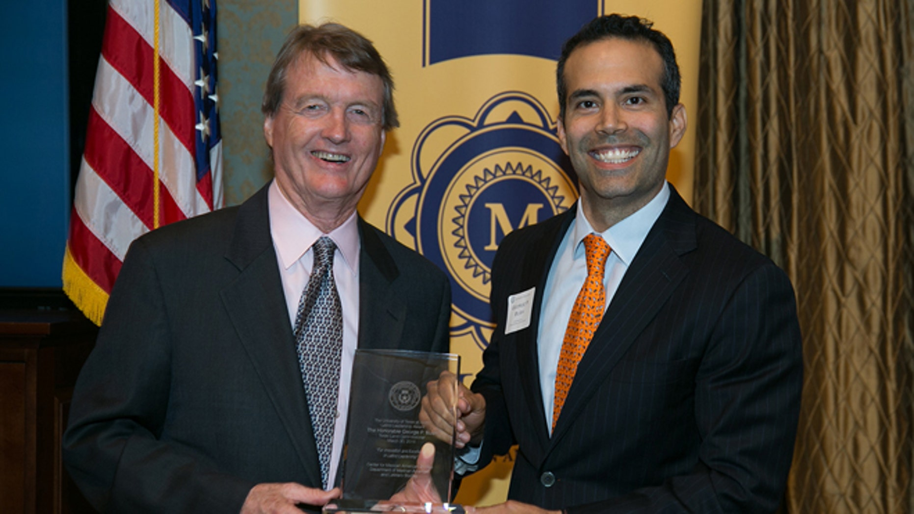 UT Austin President Bill Powers and Texas Land Commissioner George P. Bush at a reception on campus.