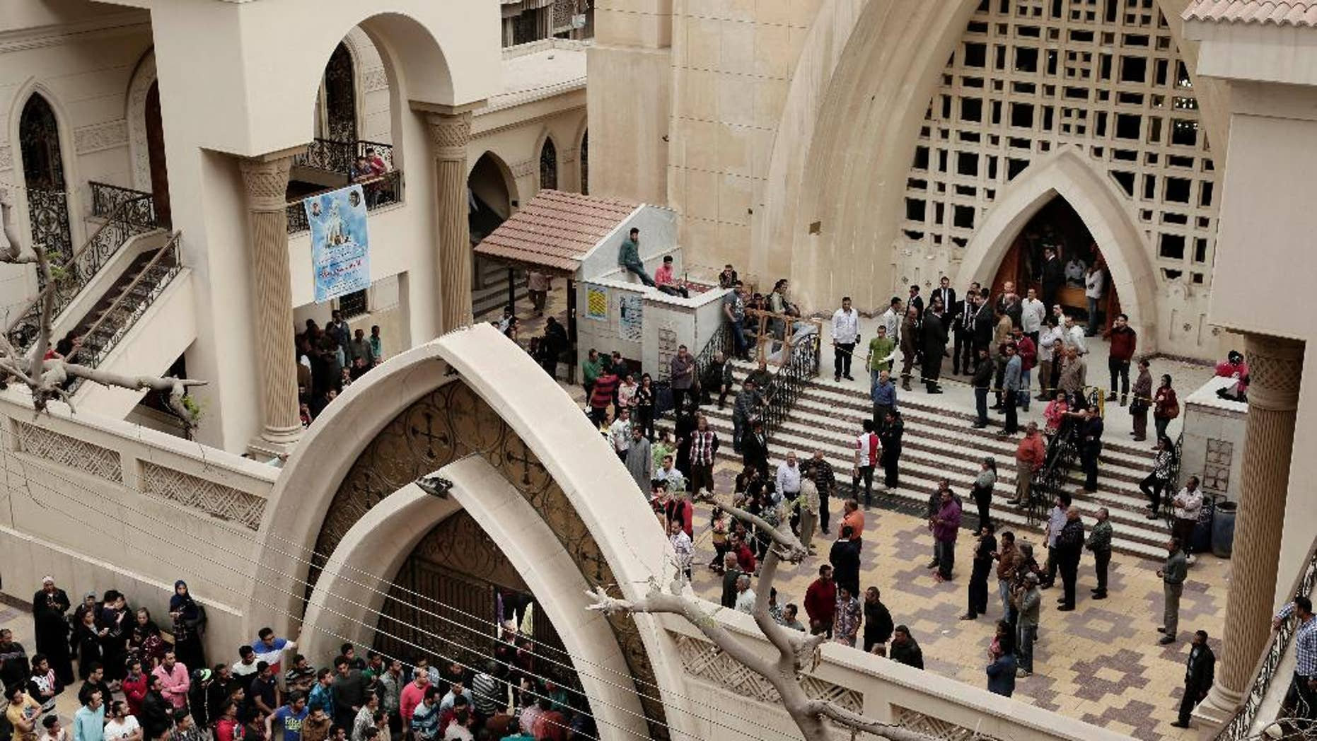 Sunday, April 9, 2017: People gather outside the St. George's Church after a deadly suicide bombing, in the Nile Delta town of Tanta, Egypt.