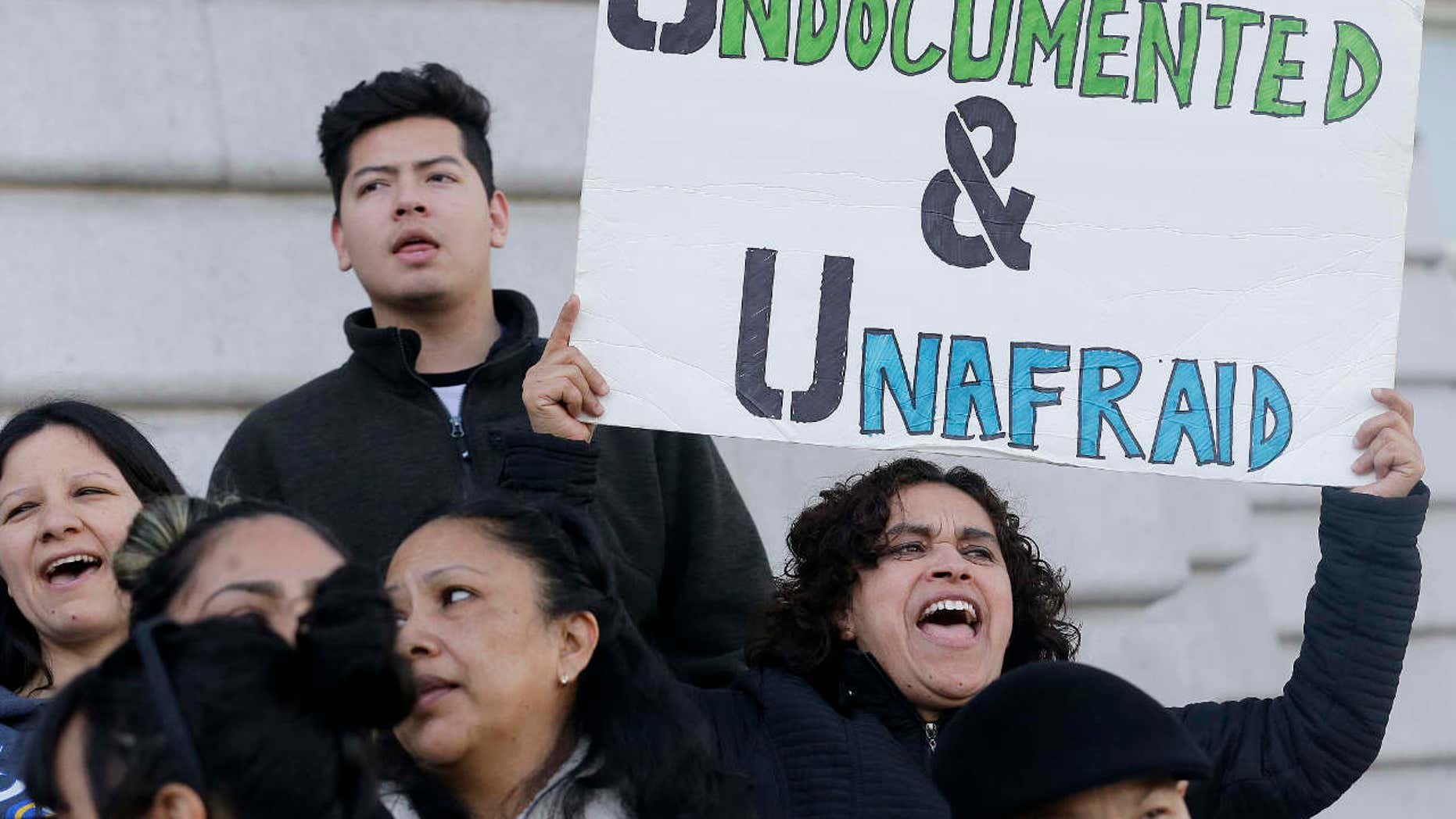 Jan. 25, 2017: Lordes Reboyoso, right, yells at a rally outside of City Hall in San Francisco.