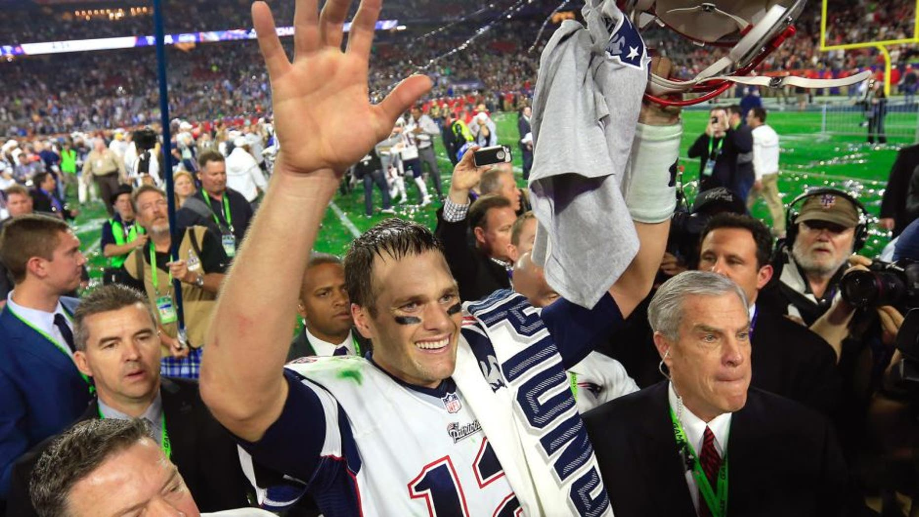 Tom Brady #12 of the New England Patriots celebrates after defeating the Seattle Seahawks during Super Bowl XLIX at University of Phoenix Stadium on February 1, 2015 in Glendale, Arizona. The Patriots defeated the Seahawks 28-24. (Photo by Rob Carr/Getty Images)