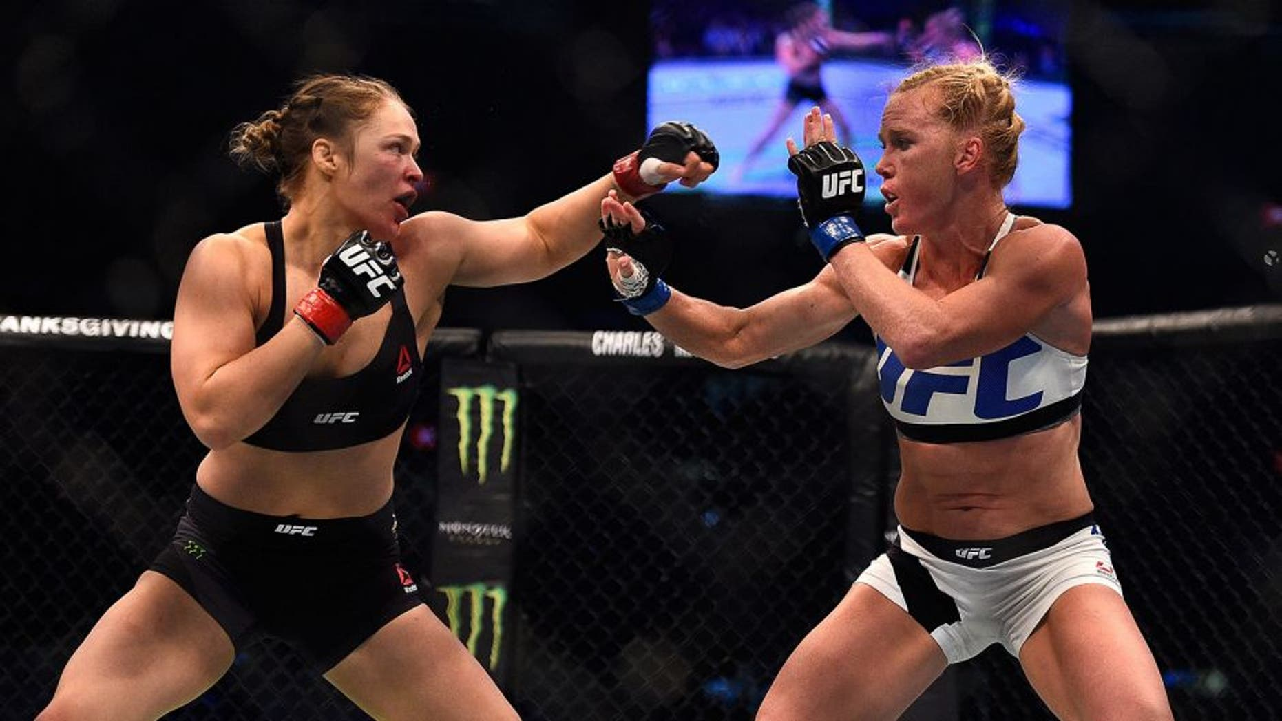 MELBOURNE, AUSTRALIA - NOVEMBER 15: (L-R) Ronda Rousey faces Holly Holm in their UFC women's bantamweight championship bout during the UFC 193 event at Etihad Stadium on November 15, 2015 in Melbourne, Australia. (Photo by Jeff Bottari/Zuffa LLC/Zuffa LLC via Getty Images)